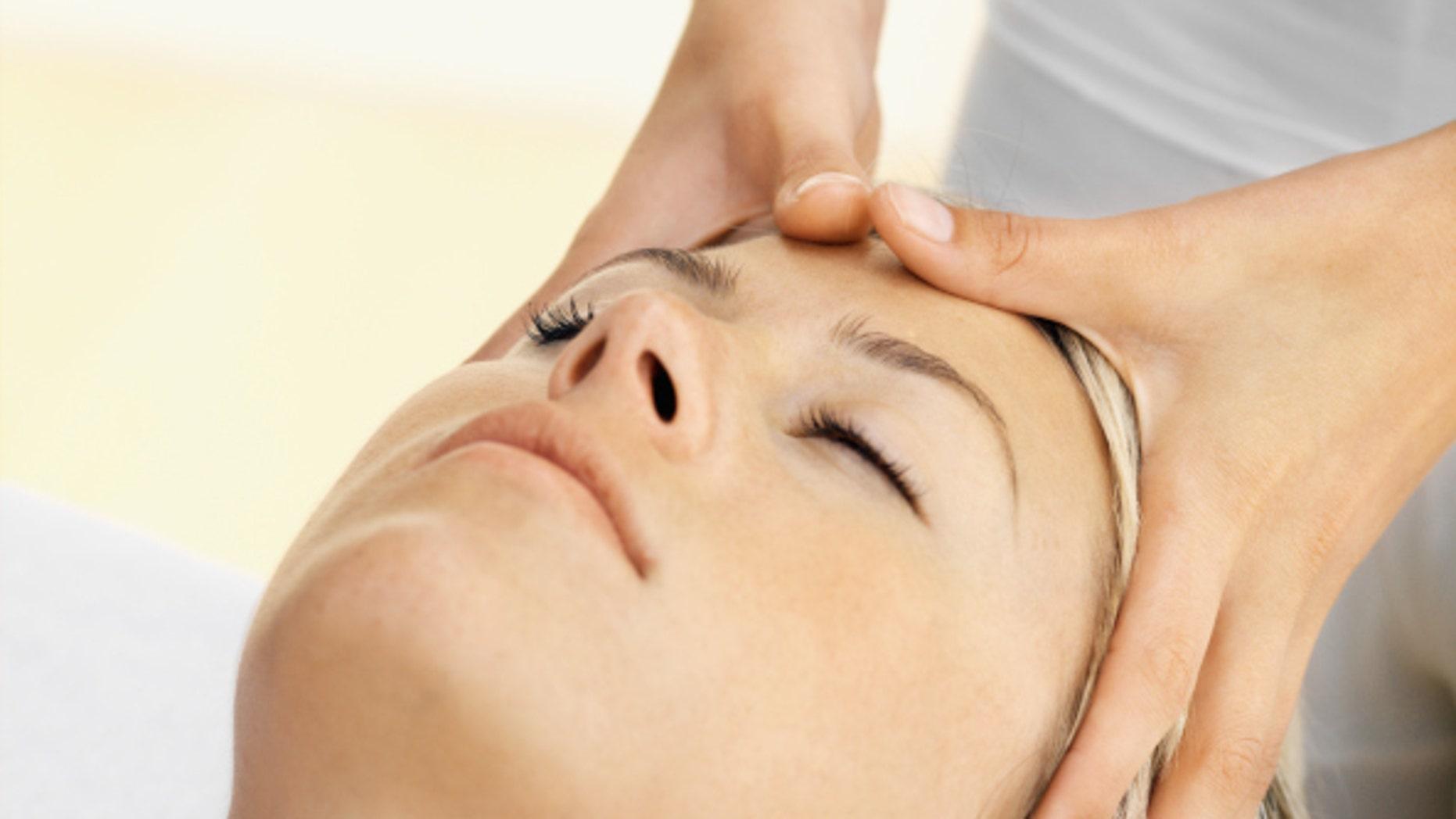 Close up of a woman receiving a head massage