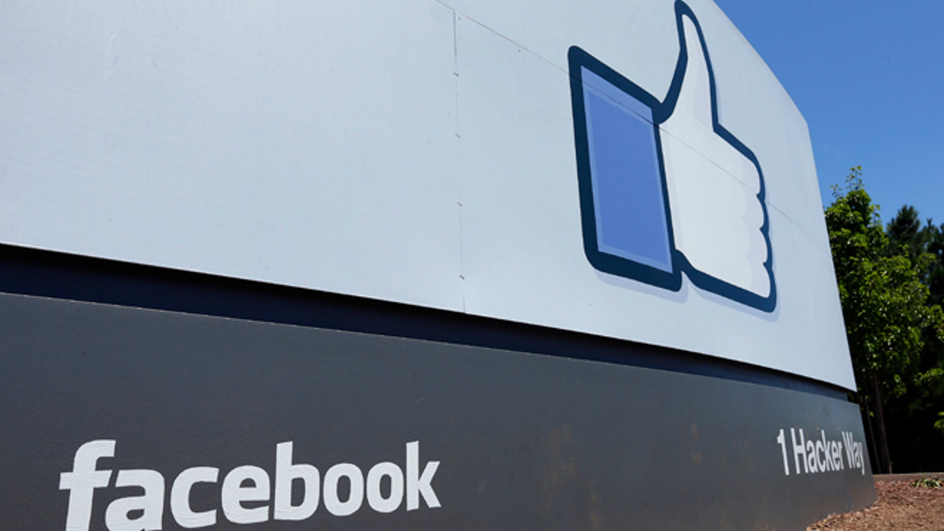 This July 16, 2013 FILE photo, shows a sign at Facebook headquarters in Menlo Park, Calif.