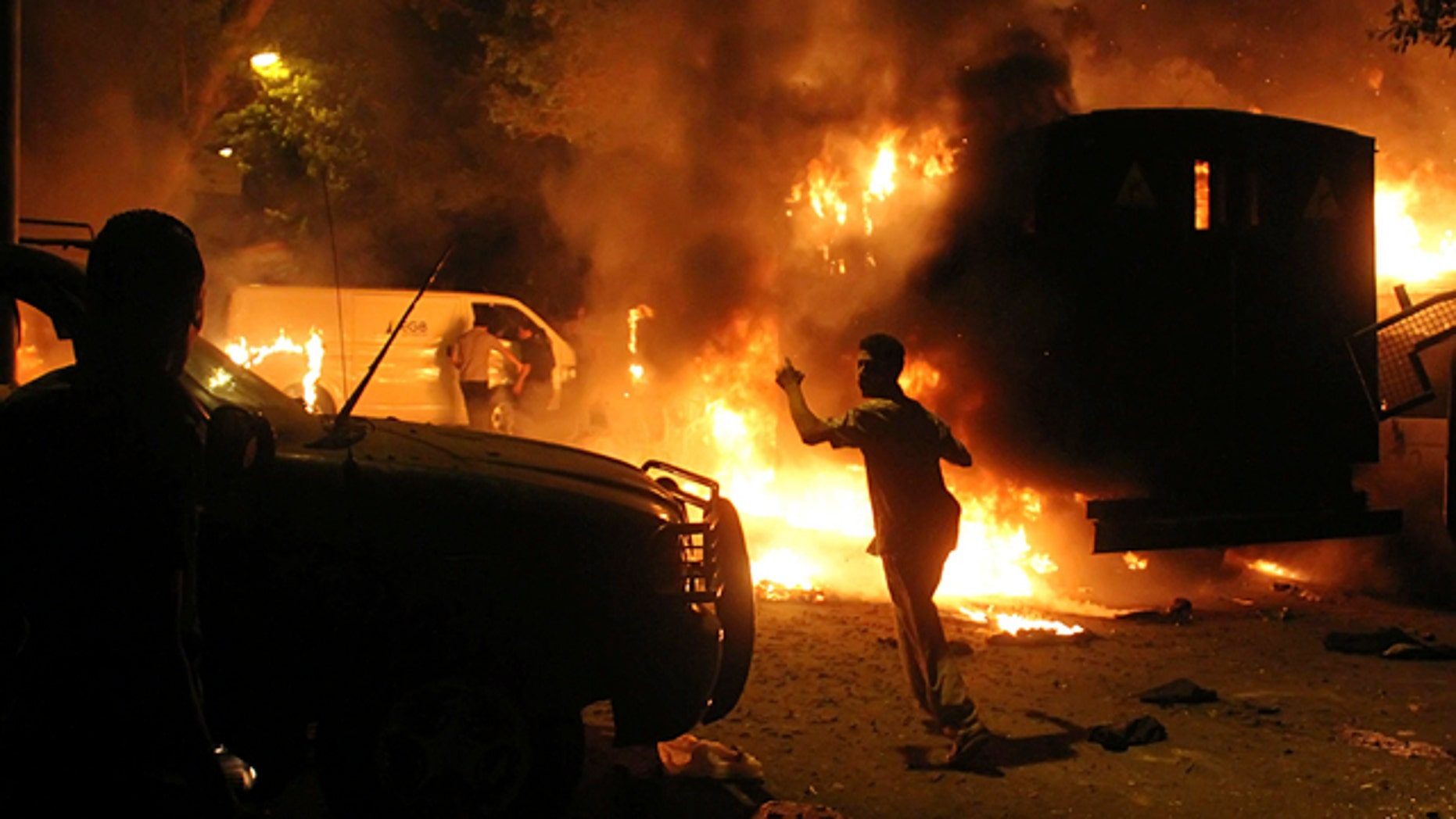 Sept. 9, 2011: Protesters are seen among flaming vehicles outside the building housing the Israeli embassy in Cairo, Egypt. A Facebook page calls for a fresh protest against the Israeli embassy in Amman, Jordan, sparking fears of more violence.