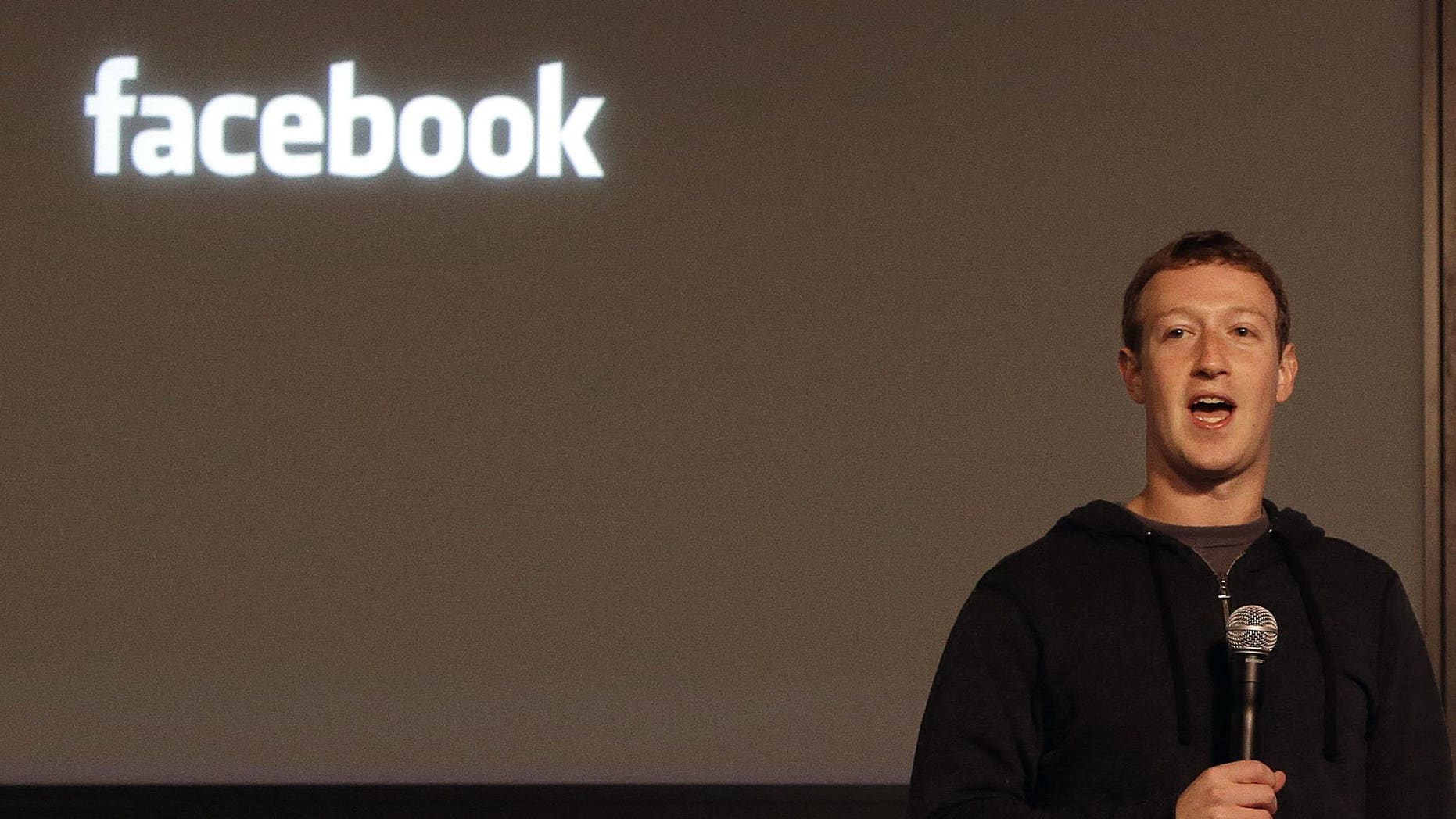 """Facebook CEO Mark Zuckerberg speaks at Facebook headquarters in Menlo Park, Calif., Tuesday, Jan. 15, 2013.  Zuckerberg introduced graph search"""" Tuesday, a new service that lets users search their social connections for information about their friends interests, and for photos and places.  (AP Photo/Jeff Chiu)"""