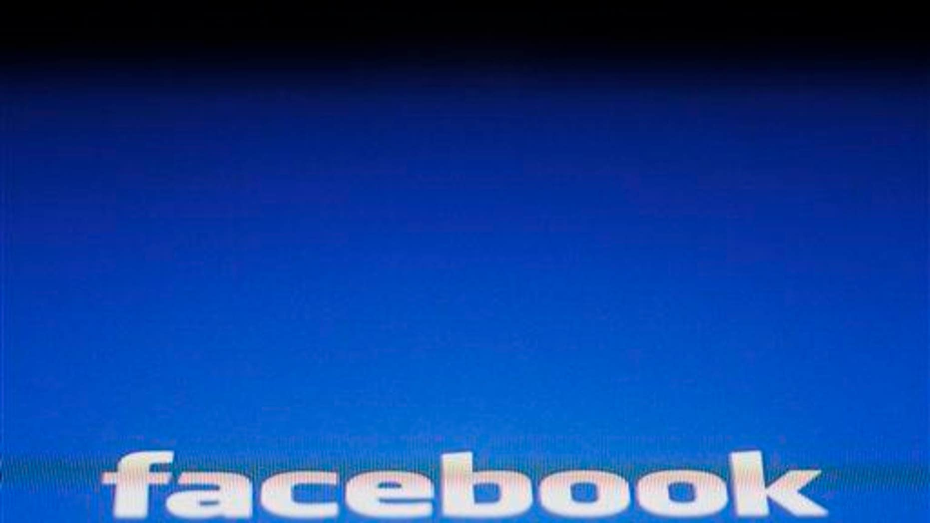 In this May 16, 2012 file photo, a Facebook logo is displayed on the screen of an iPad in New York.