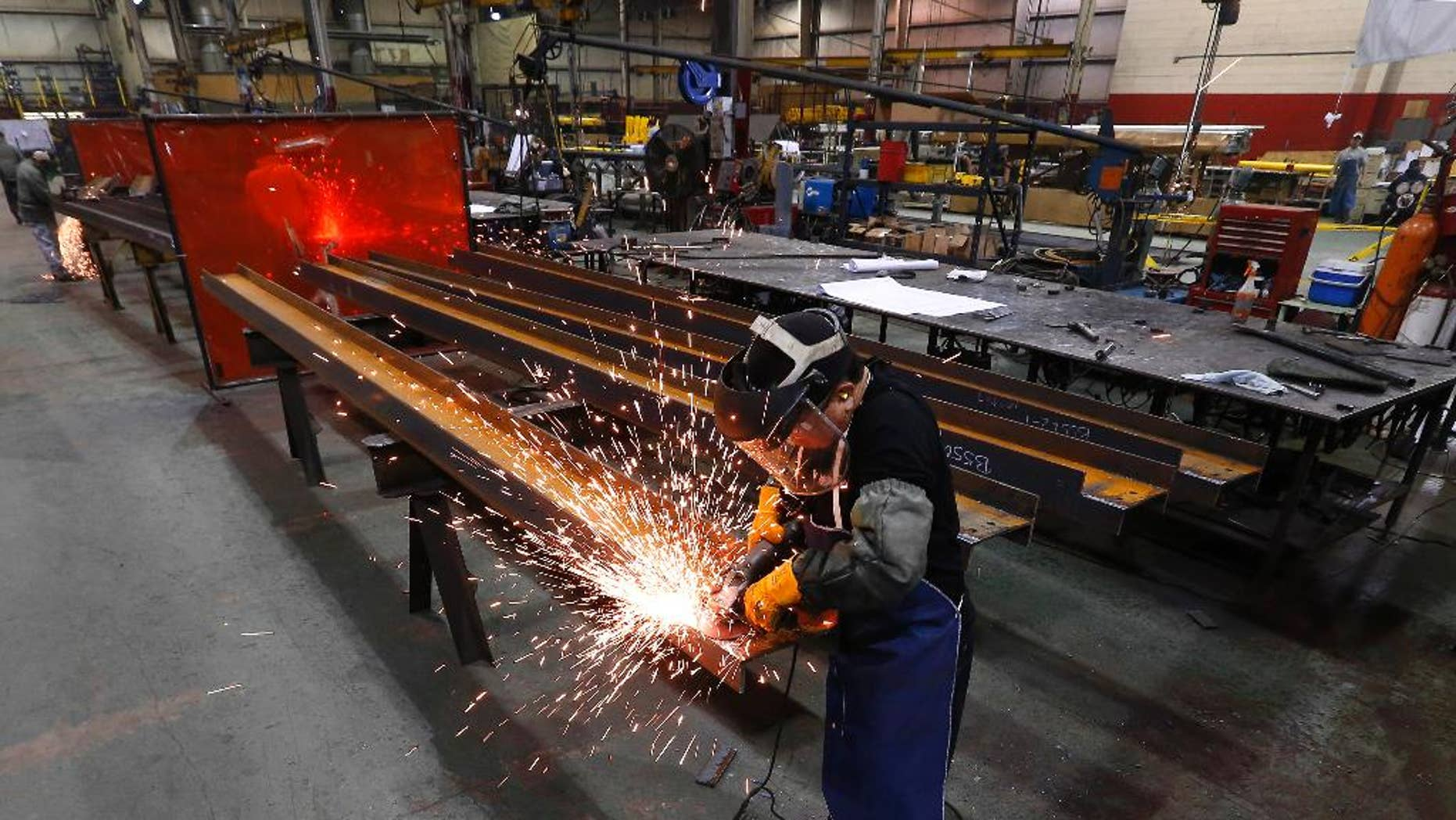In this Thursday, Jan. 23, 2014 photo, Jesus Rodriguez grinds steel at the IDEAL Group in Detroit. The Commerce Department releases factory orders for March on Friday, May 2, 2014. (AP Photo/Paul Sancya)