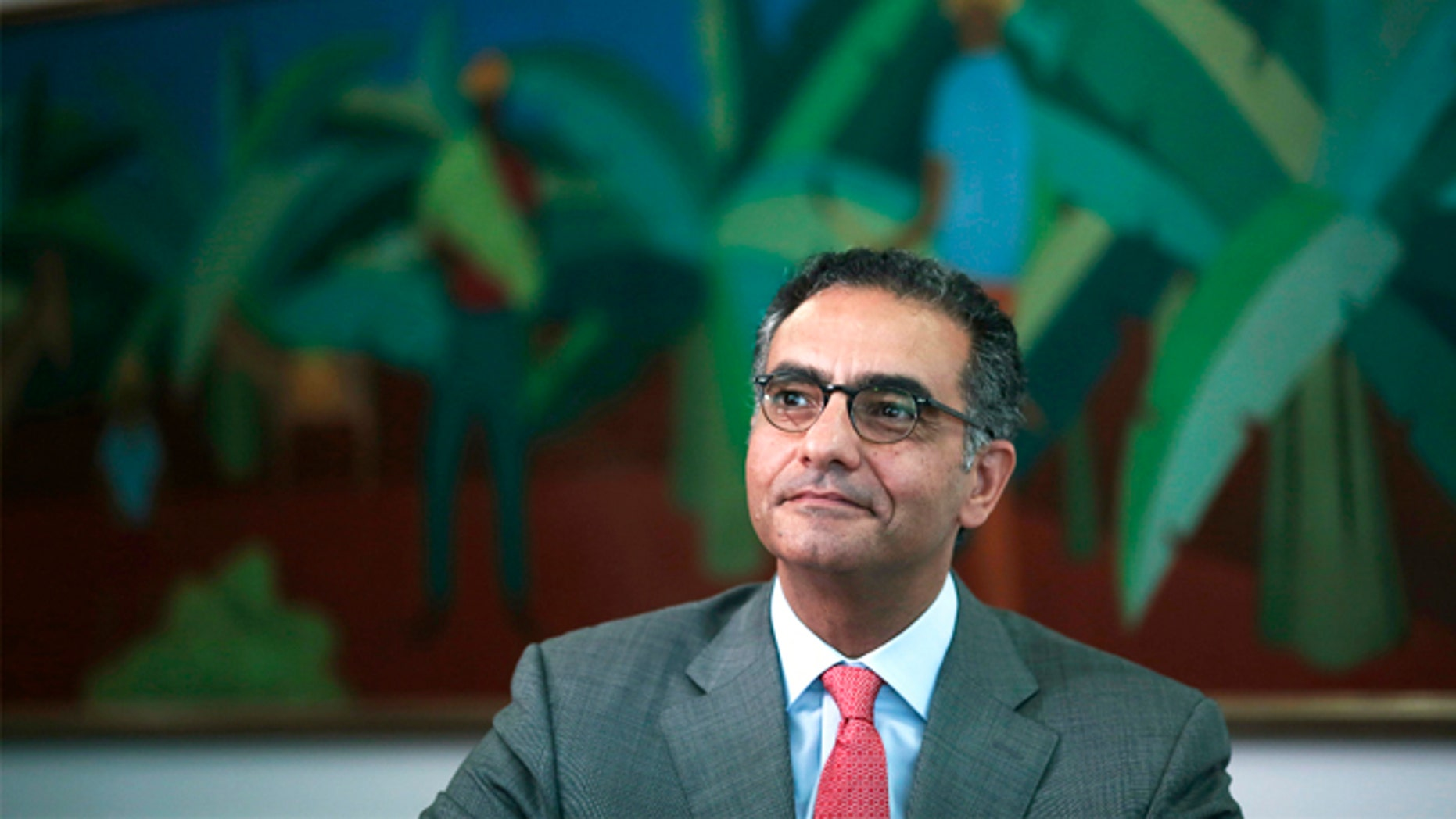 FILE -- October 9, 2013: Fadi Chehade, president and CEO of Internet Corporation for Assigned Names and Numbers (ICANN), attends a meeting with Brazil's President Dilma Rousseff (not seen) at the Planalto Palace in Brasilia.