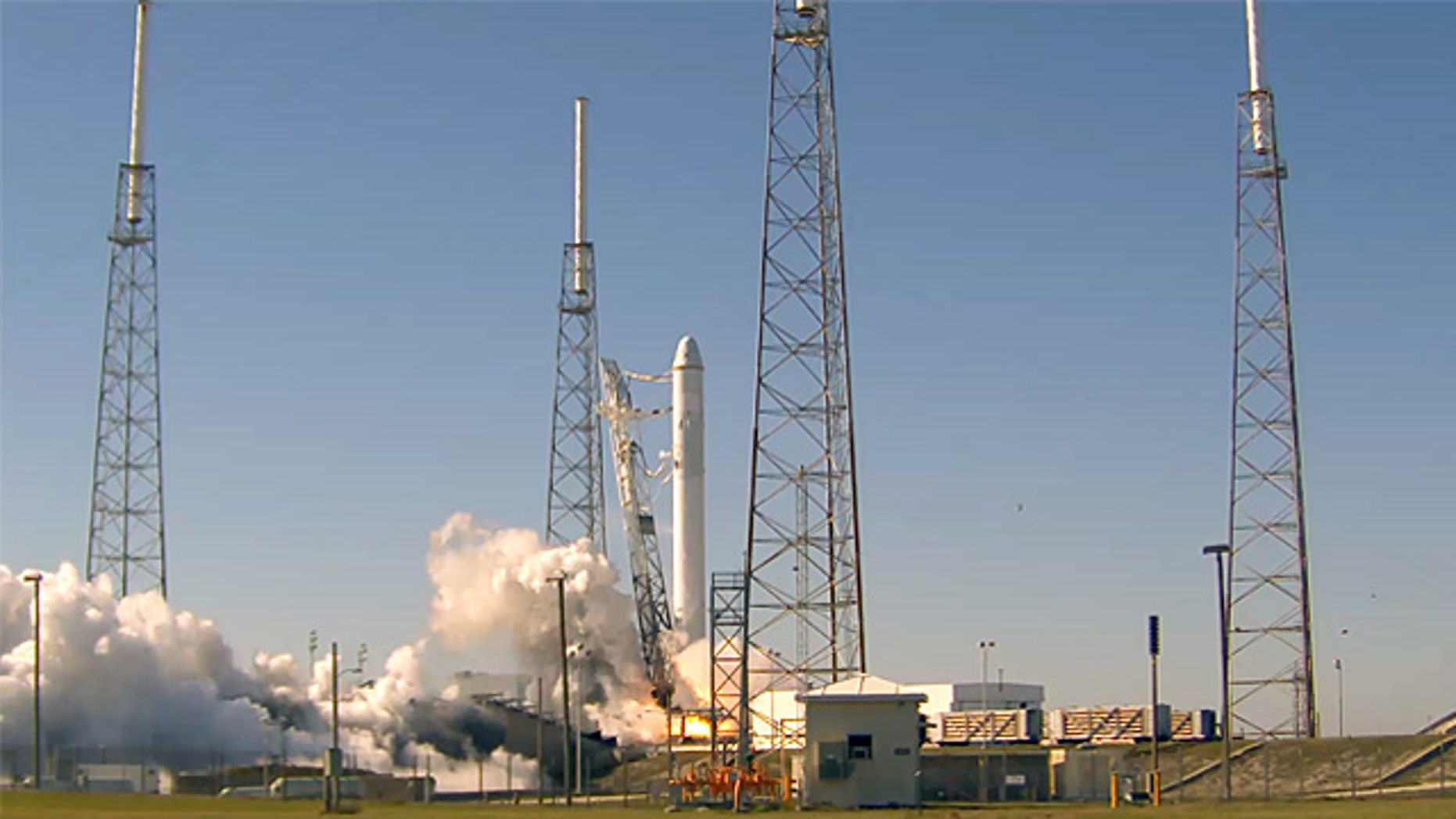 """All nine liquid oxygen and kerosene-burning engines fired at once during SpaceX's """"static fire test"""" on Launch Complex 40 at the U.S. Air Force Station at Cape Canaveral."""