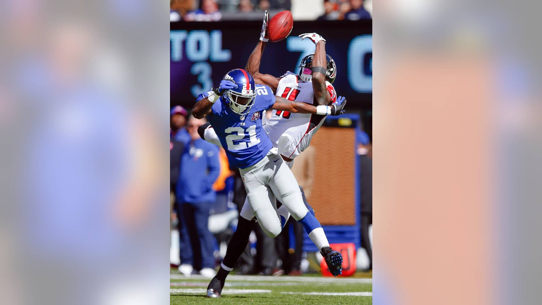 Atlanta Falcons wide receiver Julio Jones (11) is unable to catch a pass as New York Giants cornerback Dominique Rodgers-Cromartie (21) defends during the first half of an NFL football game, Sunday, Oct. 5, 2014, in East Rutherford, N.J. (AP Photo/Kathy Willens)