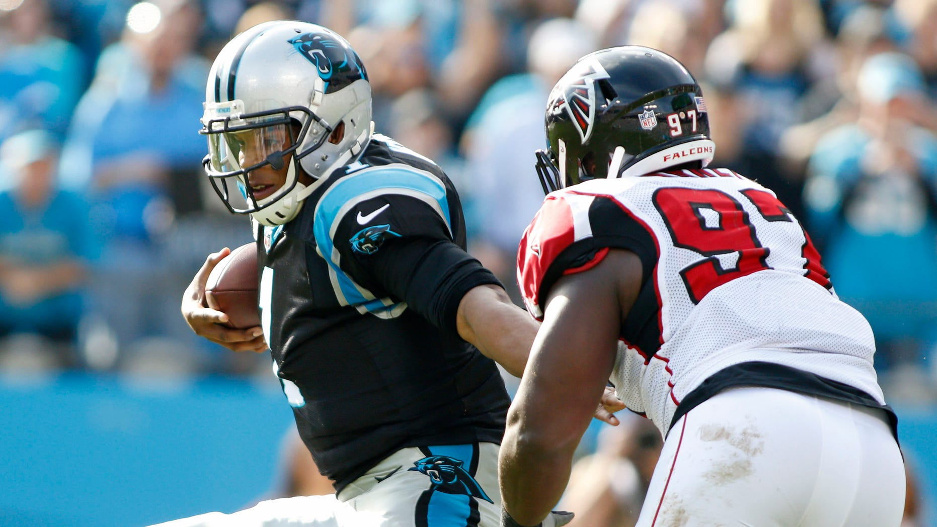 Carolina Panthers' Cam Newton (1) breaks away from Atlanta Falcons' Grady Jarrett (97) in the first half of an NFL football game in Charlotte, N.C., Sunday, Dec. 13, 2015. (AP Photo/Bob Leverone)