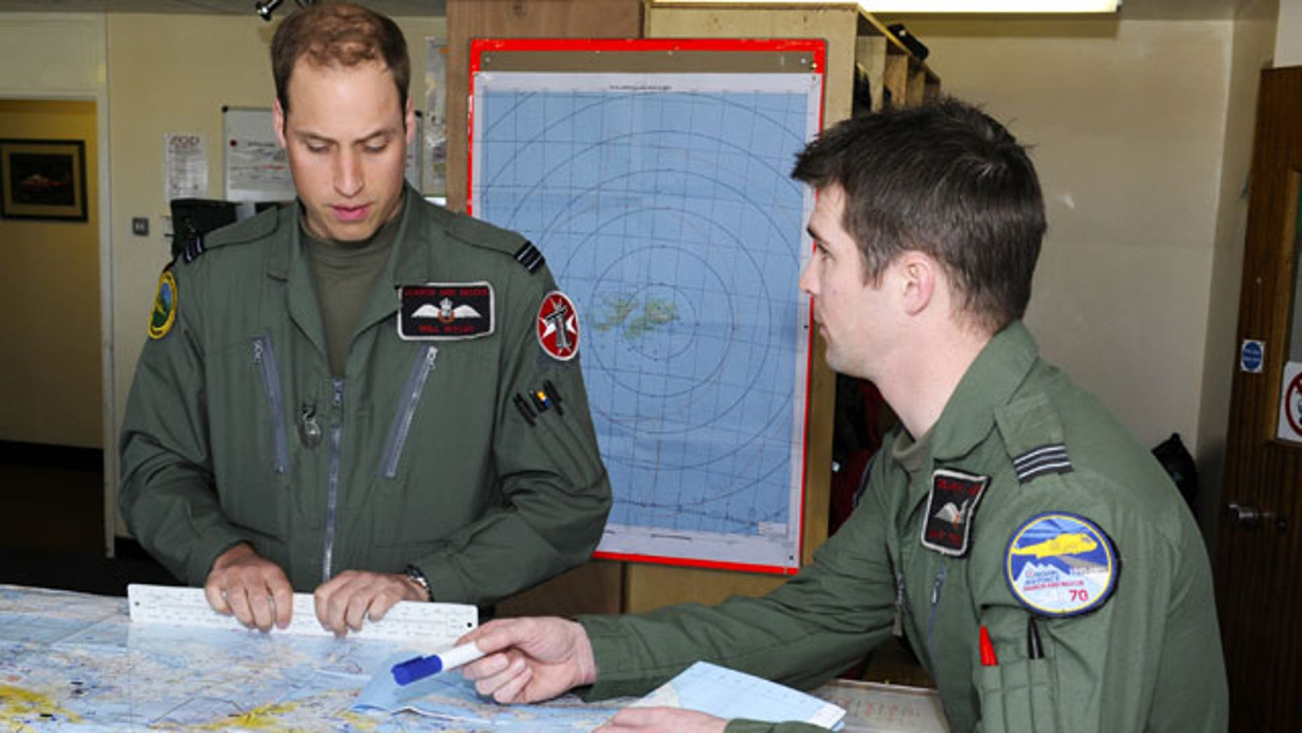 Feb. 4, 2012: Britain's Ministry of Defense, Prince William, left, prepares for his first sortie with a crew member at Mount Pleasant Complex in the Falkland Islands, part of his six week deployment to the Islands.