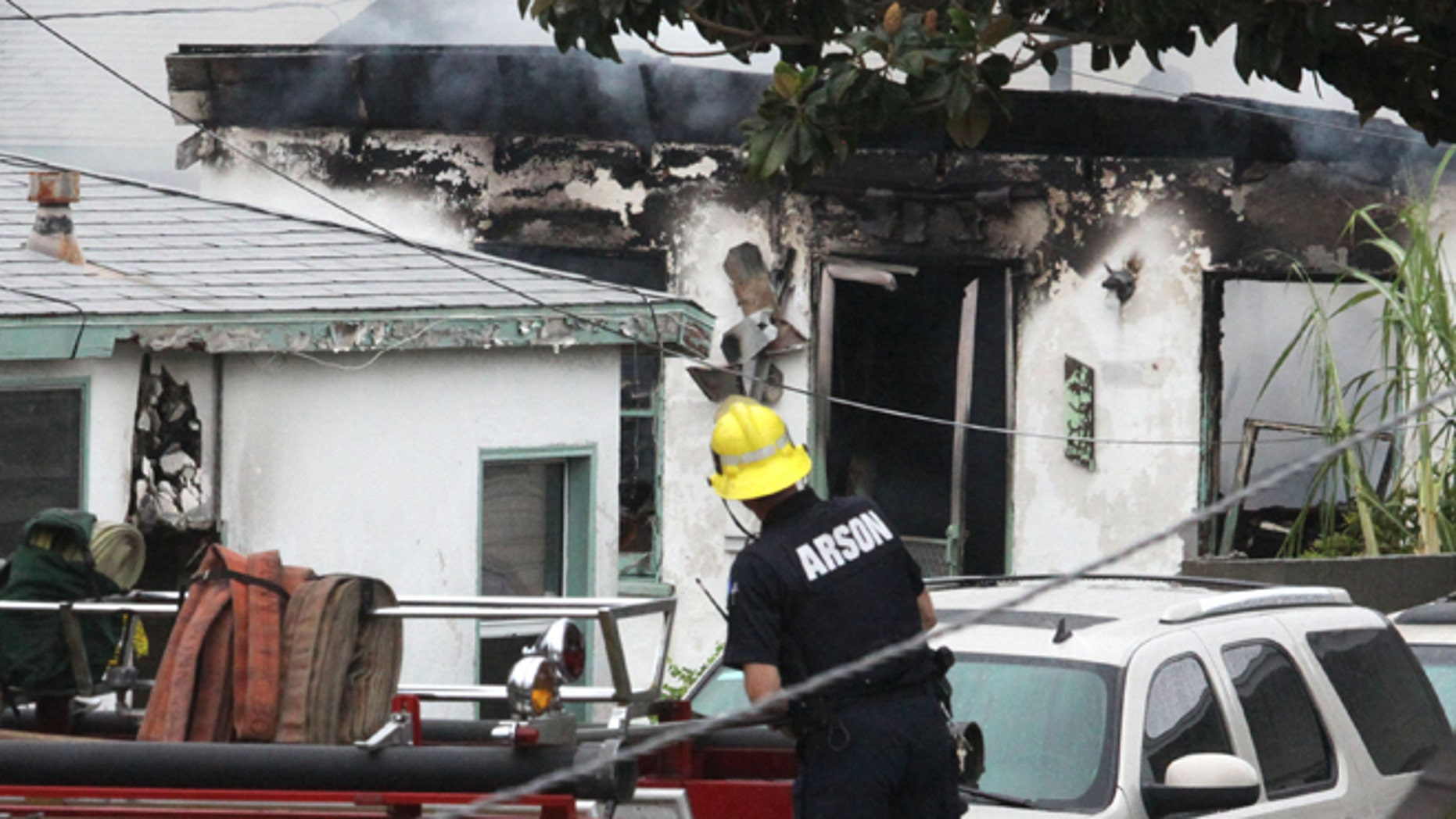 Oct. 20, 2012: Inglewood, Calif, emergency personnel respond to the scene where a man, wearing a mask, set a duplex on fire and then shot five members of a family.