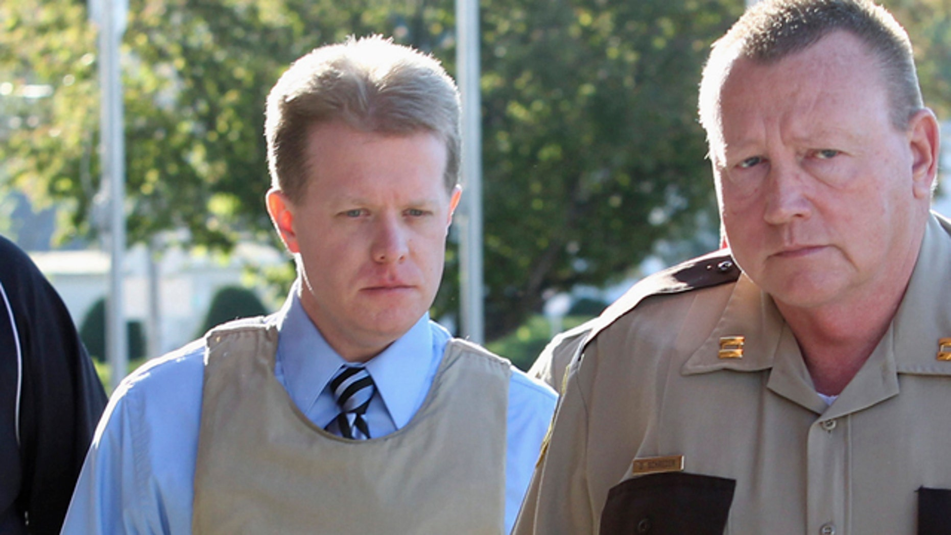 April 12: Murder suspect Christopher Coleman, left, accused of strangling his wife and their two sons, is escorted to the Perry County Courthouse during jury selection in his trial in Pinckneyville, Ill.