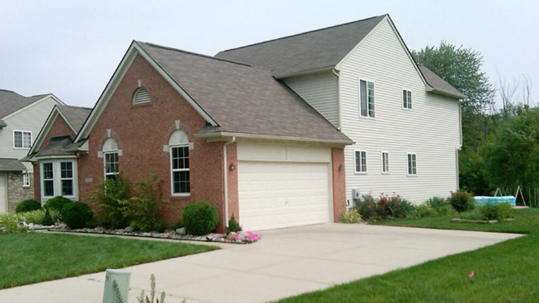 Aug. 16, 2012: A home in Van Buren Township, Mich., where police say they found a woman and her two young sons dead when they went there to notify the family of a fiery, fatal crash in Indiana.