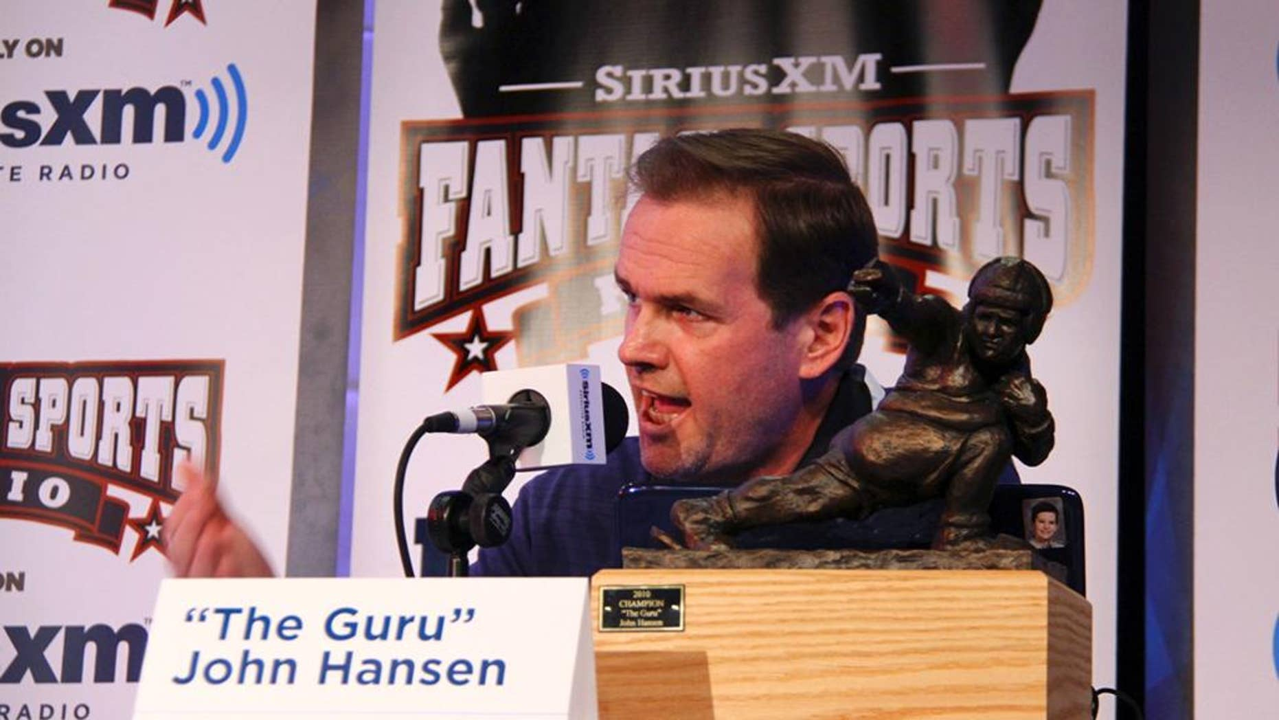 In this photo taken on July 28, 2011, and provided by SiriusXM, John Hansen speaks at the SiriusXM Celebrity Fantasy Football Draft at the Hard Rock Cafe in New York. Hansen started out faxing and snail-mailing his fantasy football advice and hosting a local cable TV show. Technology has supercharged the growth of fantasy leagues, and now Hansen appears nationally on satellite radio and television talking about who to start and sit. (AP Photo/SiriusXM, Maro Hagopian)