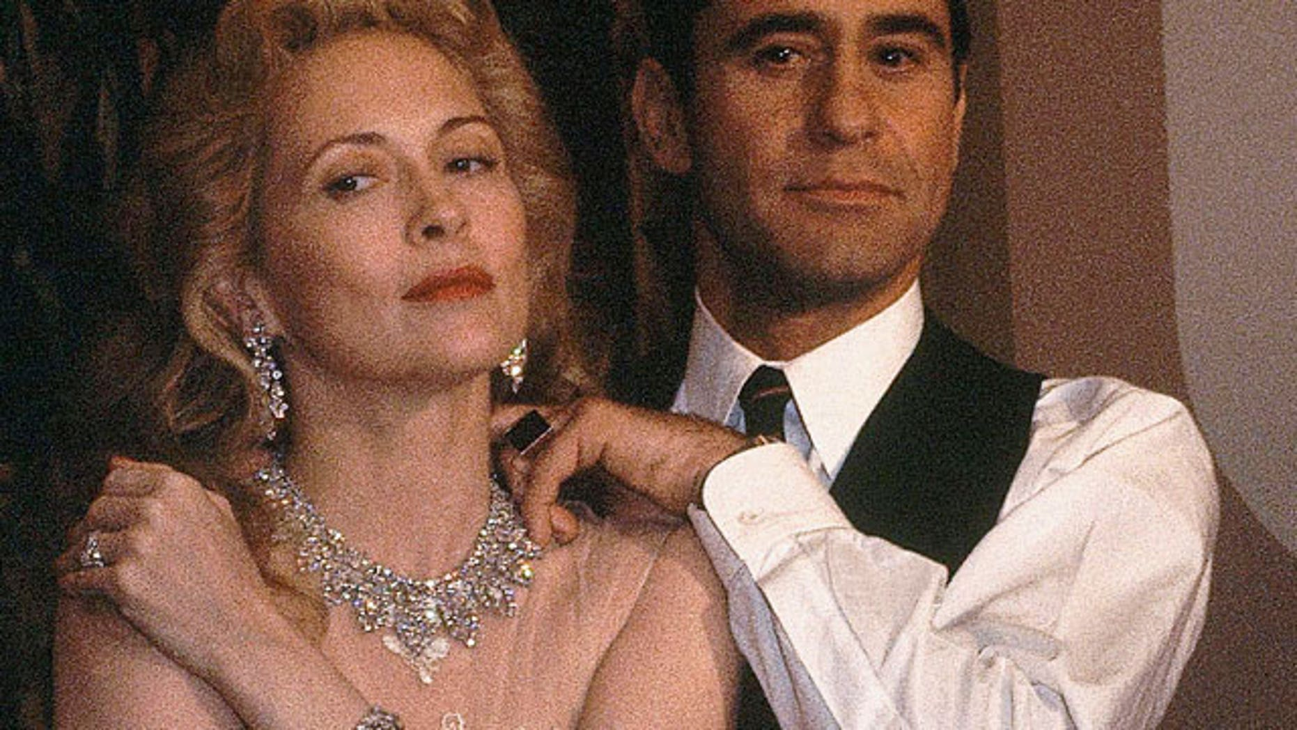 """This Nov. 11, 1980, file photo shows James Farentino and Faye Dunaway, who star in """"Evita Peron,"""" in Los Angeles. A family spokesman says actor Farentino, who appeared in dozens of movies and television shows, has died in a Los Angeles hospital. He was 73. (AP)"""