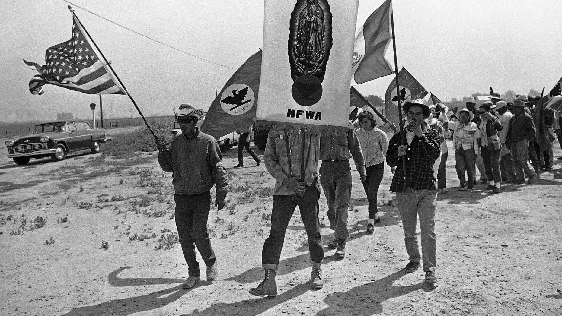 FILE - In this April 7, 1966 file photo, grape strikers on a 300-mile march from Delano, Calif., approach their goal, the Capitol in Sacramento.