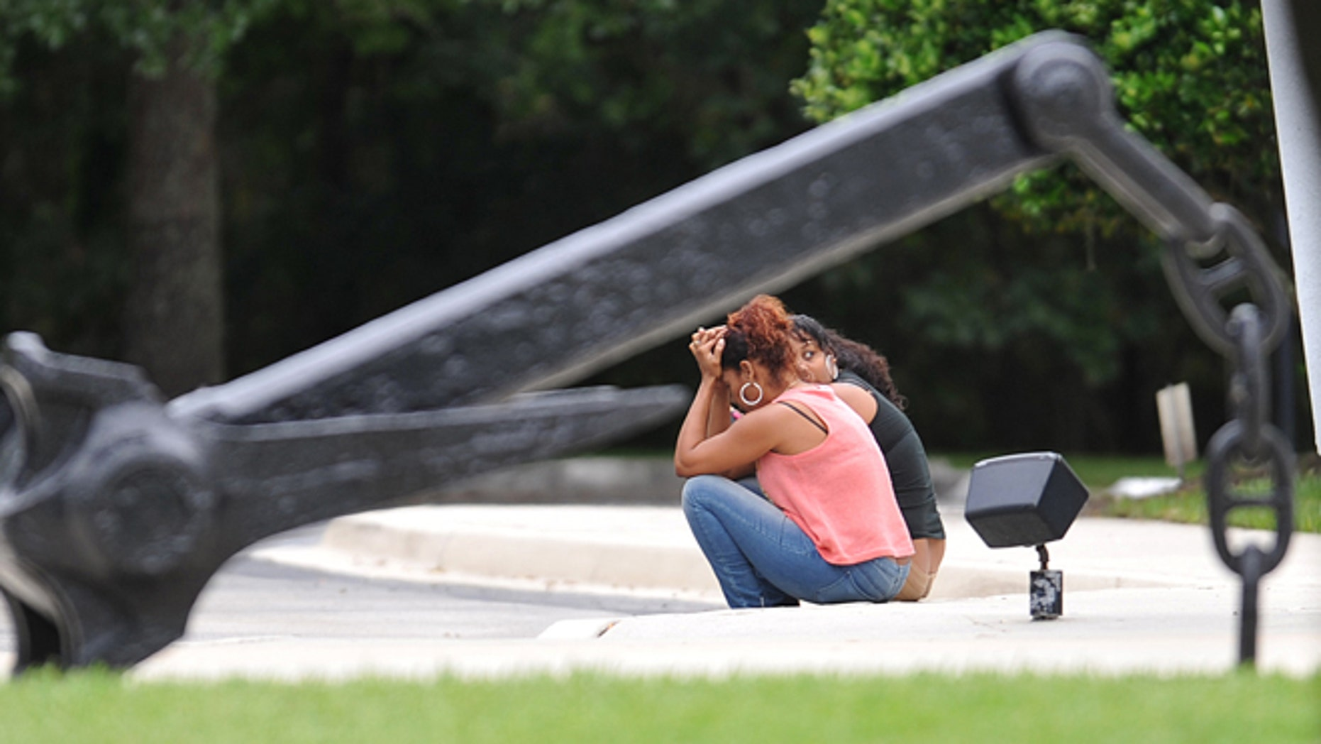 Families have gathered at the Seafarers Union Hall Sunday, Oct. 4, 2015, in Jacksonville, Fla., waiting for news on the crew of 33 aboard the missing cargo ship El Faro. (Bruce Lipsky/Florida Times-Union via AP)