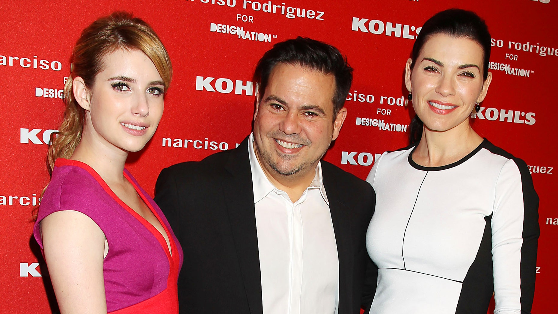 This Oct. 22, 2012 photo released by Starpix shows actress Emma Roberts , left, with fashion designer Narciso Roriguez, center and actress Julianna Margulies at the Narciso Rodriguez for DesigNation launch in partnership with Kohl's department store in New York. Rodriguez has joined the likes of Jason Wu and Missoni by launching a limited-edition collection with a more affordable national retailer. (AP Photo/Starpix, Dave Allocca)