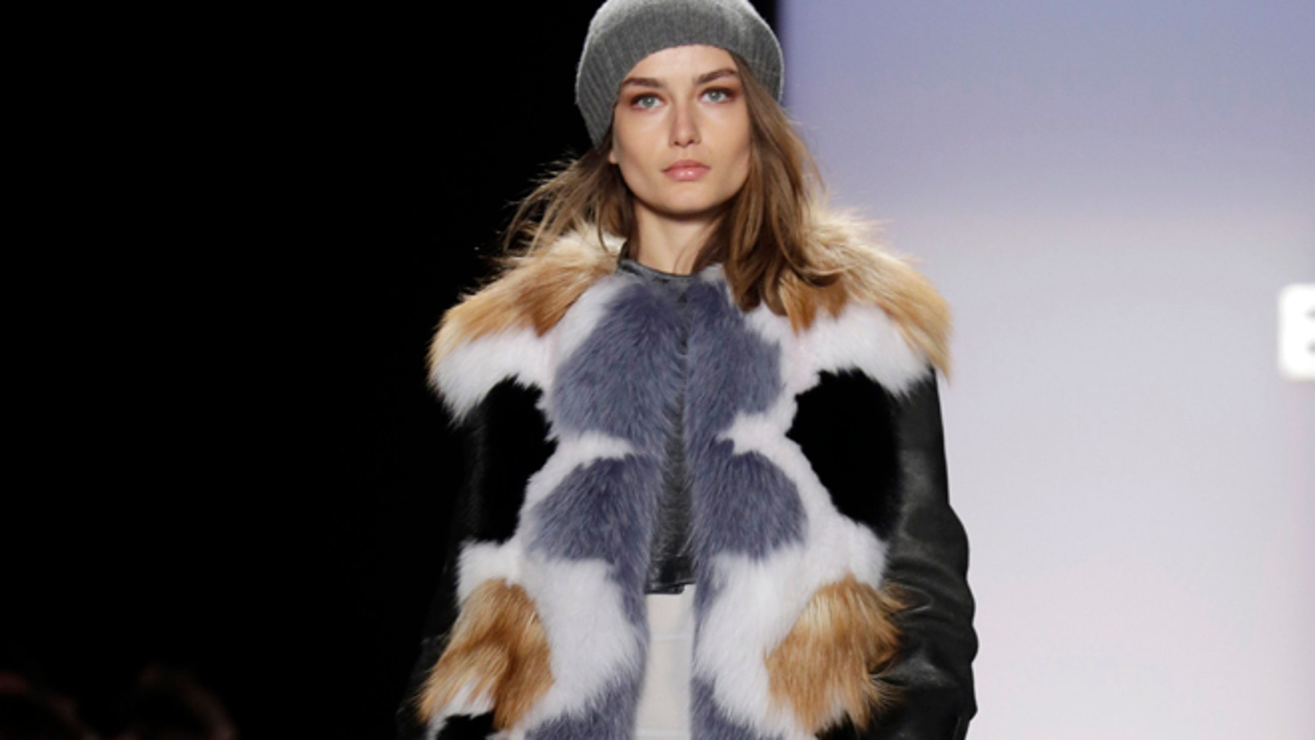 The BCBG Max Azria Fall 2013 collection is modeled during Fashion Week in New York on Thursday, Feb. 7, 2013.