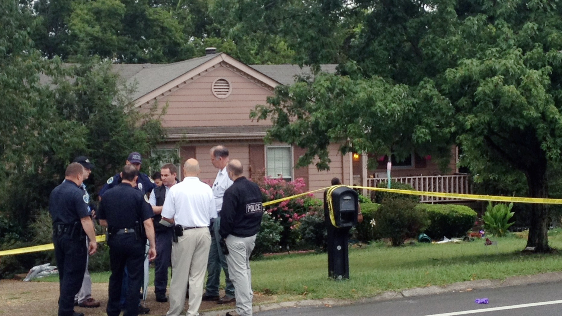 Sept. 2, 2012: Police gather near the site where three people were killed in the Nashville suburb of Bellevue, Tenn.