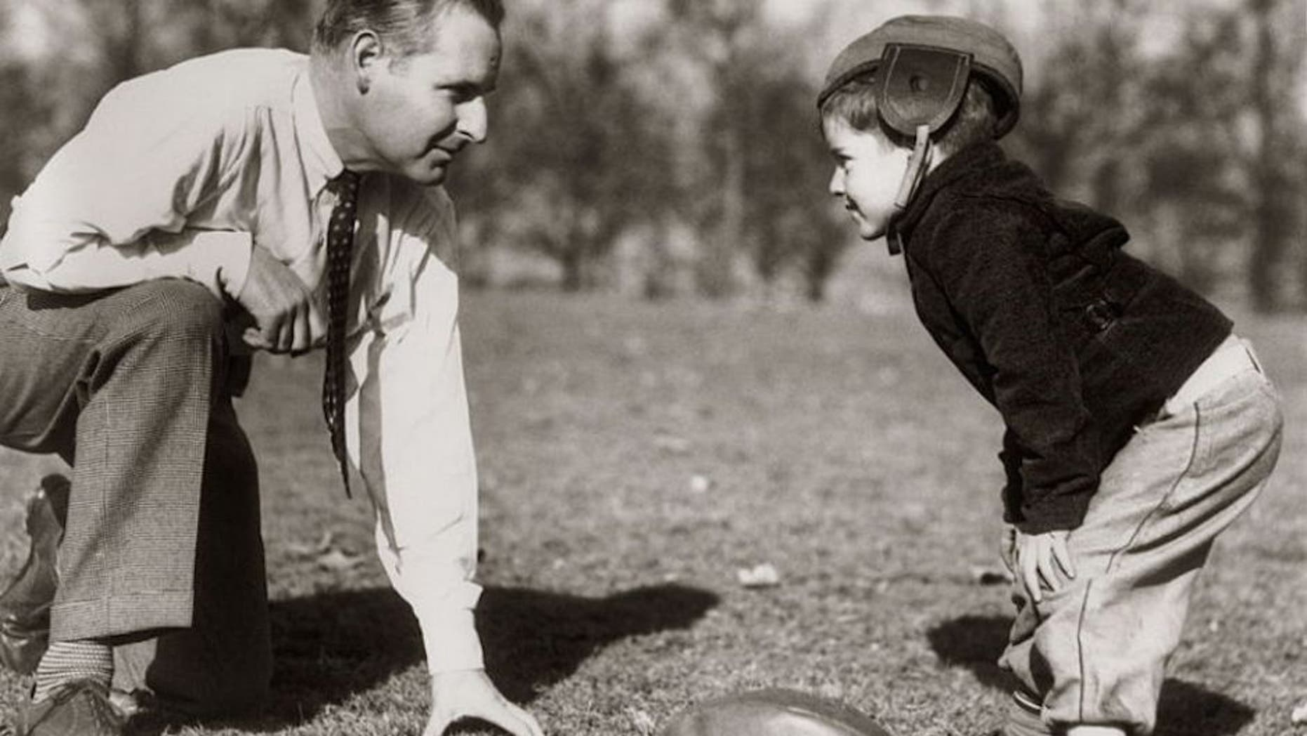 UNITED STATES - Circa 1930s: Father & Son Playing Football. (Photo by H. Armstrong Roberts/Retrofile/Getty Images)