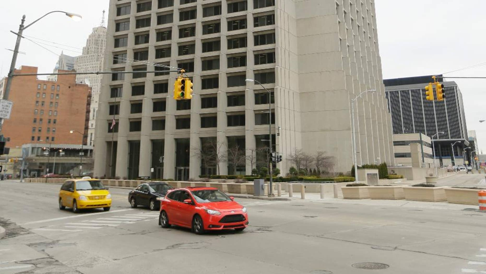 This Friday, April 3, 2015 photo shows the Patrick V. McNamara Federal Building in Detroit. Gary Mikulich, accused of planting a bomb outside of the building four years ago, may never stand trial despite extraordinary efforts to improve his mental health. (AP Photo/Carlos Osorio)