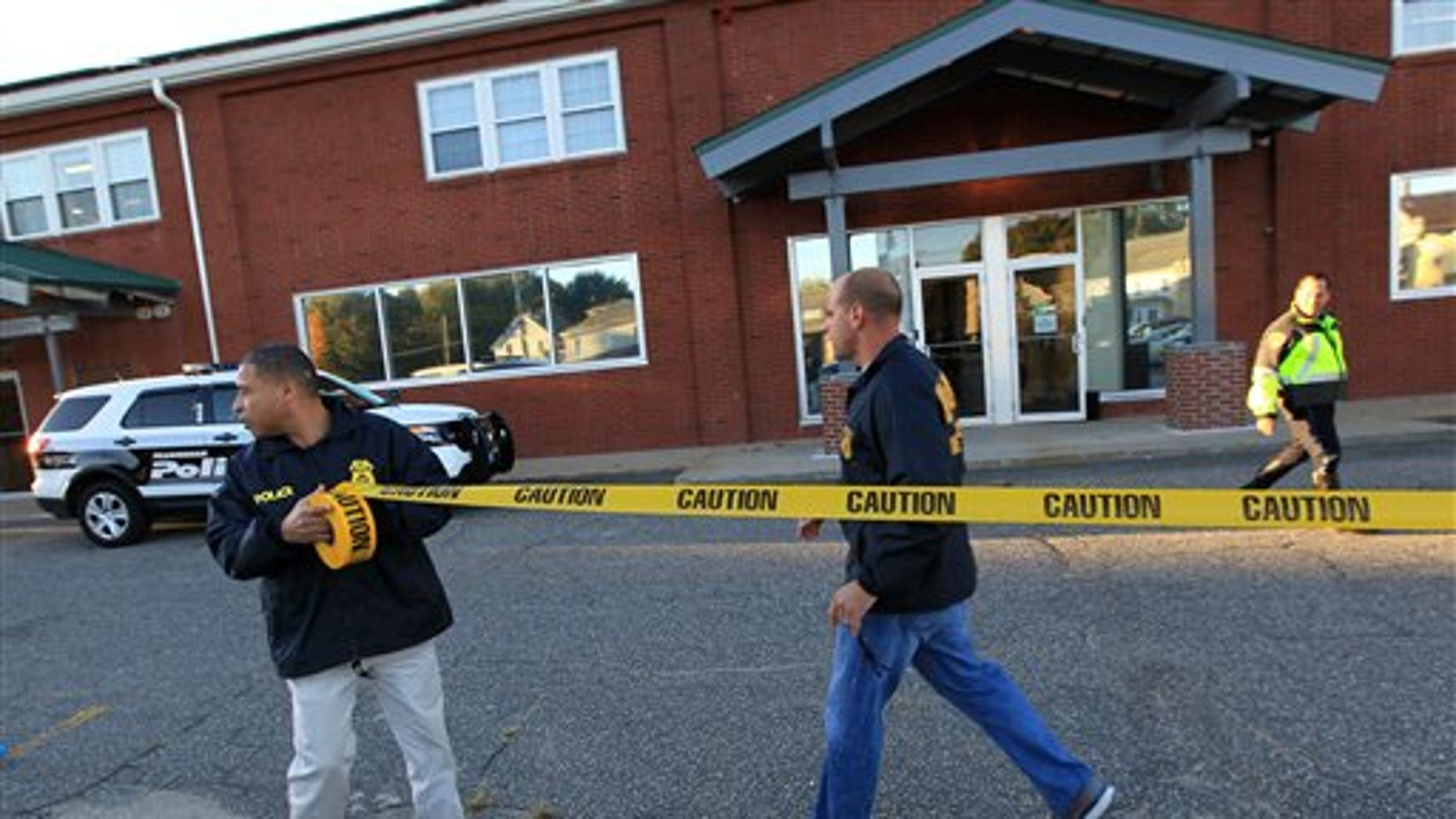 Federal agents investigate the offices of New England Compounding Center in Framingham, MA.