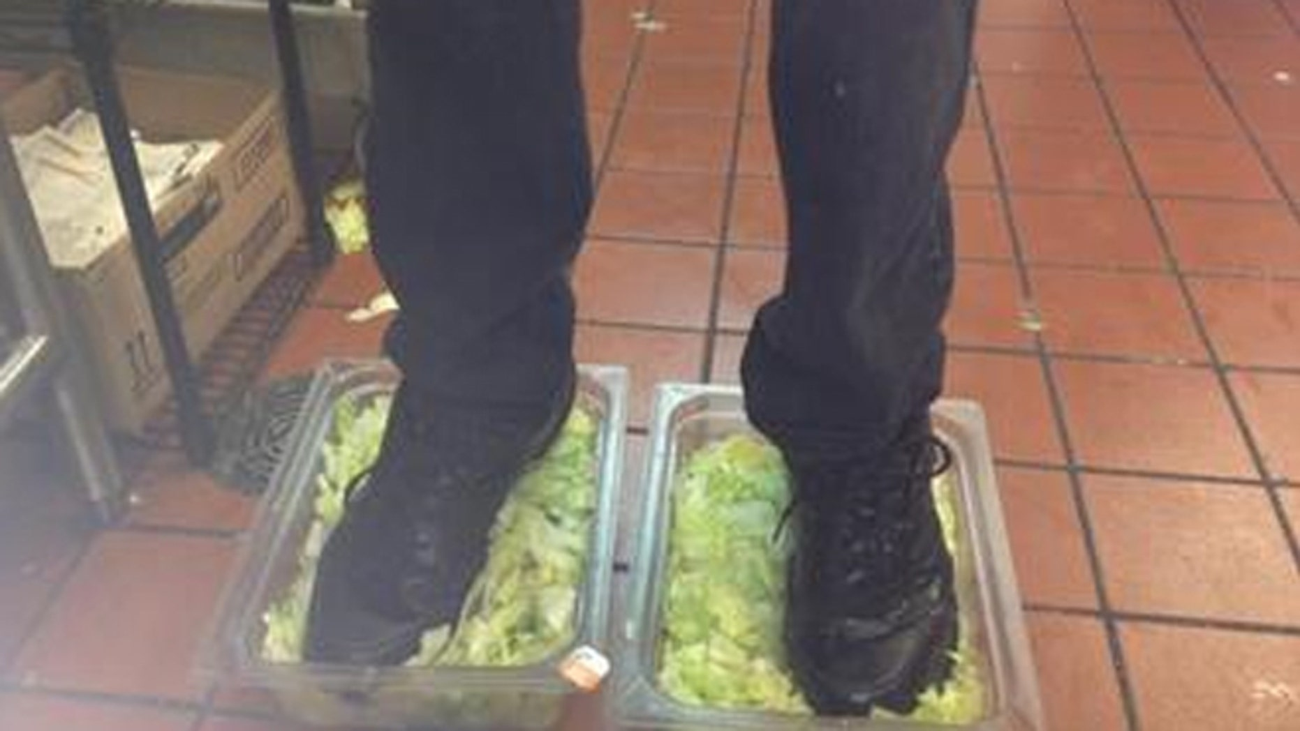 A photo that reportedly shows a Burger King employee standing on lettuce was posted on a social-networking website.