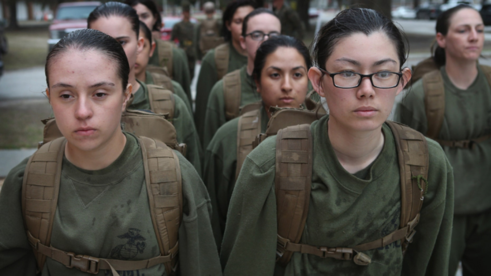 PARRIS ISLAND, SC - FEBRUARY 25:  Female Marine recruits stand in formation during boot camp February 25, 2013 at MCRD Parris Island, South Carolina. All female enlisted Marines and male Marines who were living east of the Mississippi River when they were recruited attend boot camp at Parris Island. About six percent of enlisted Marines are female.  (Photo by Scott Olson/Getty Images)