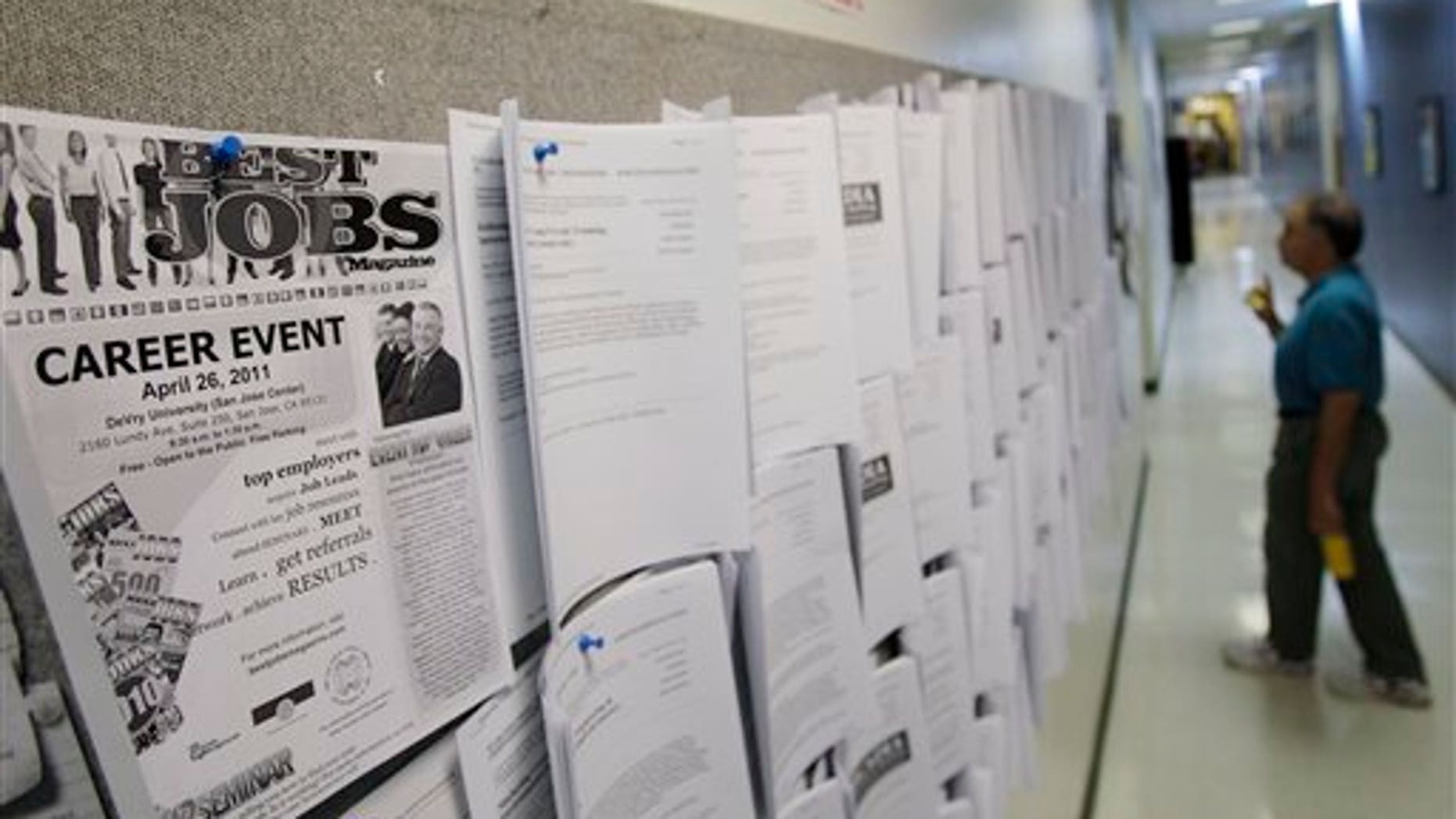 April 1: An unemployed man looks at job listings in Menlo Park, Calif.