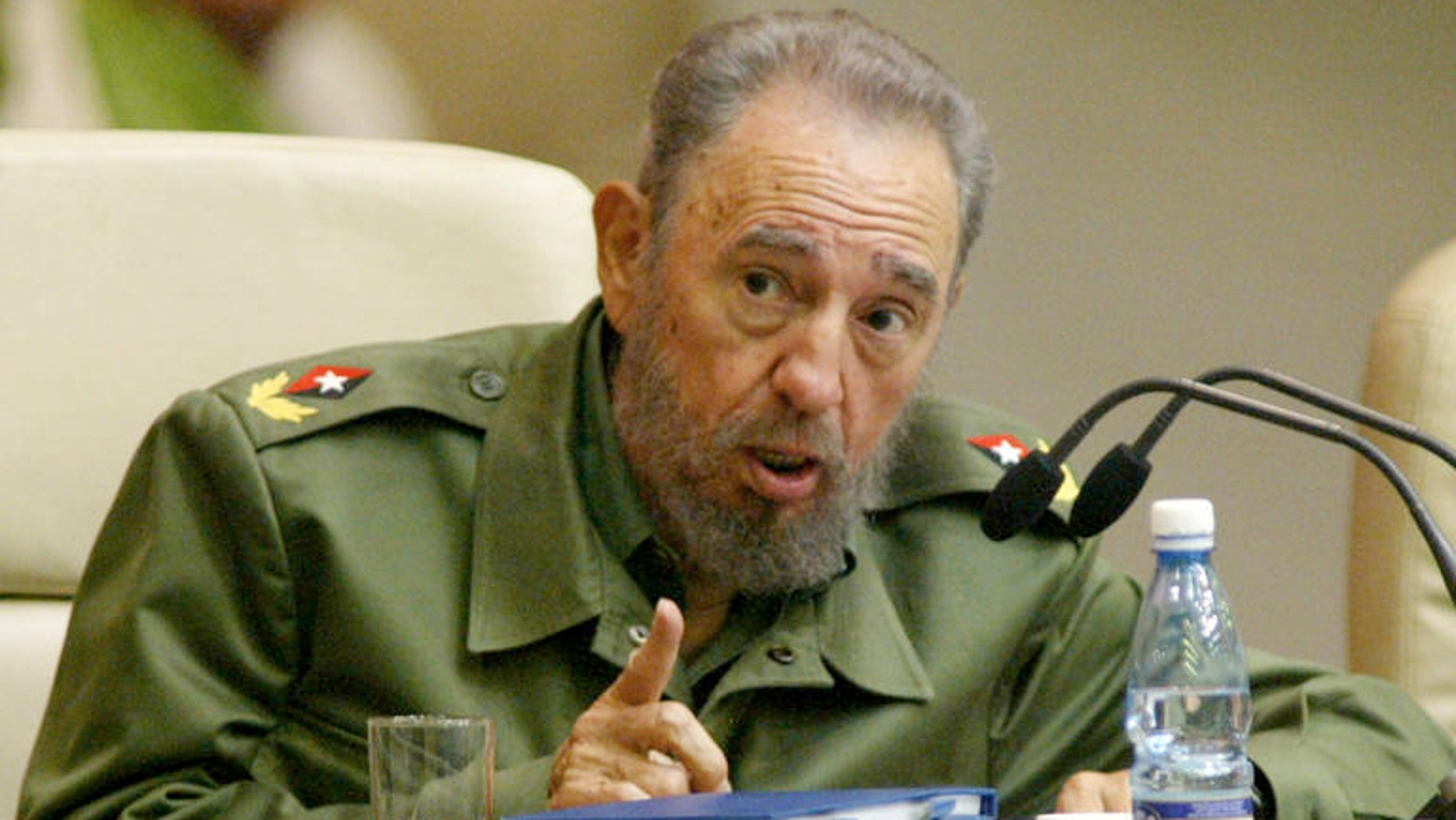 President Fidel Castro attends an anti-terrorism conference in Havana, Cuba, Saturday, June 6, 2005. For decades, participants said, the United States has been behind efforts to suppress leftist movements in Latin America, from the backing of the region's violent, right-wing military dictatorships in the 1970s and 1980s to the current meddling in the politics of liberal-led countries. The policy, they said, has again reared its head with the current handling of a Cuban militant wanted in Venezuela for an airliner bombing _ the issue that spawned the conference, originally a three-day event that host Castro extended to run a fourth day Sunday. (AP Photo/Jorge Rey)