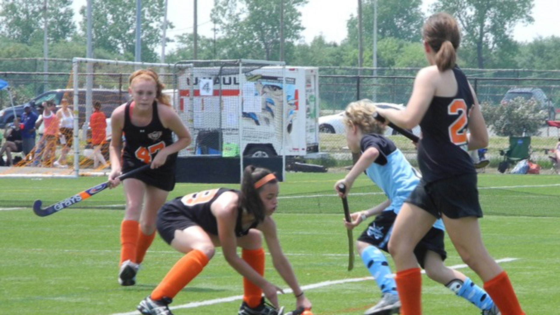 In this undated photo provided by Andrew Pilaro, Keeling Pilaro, 13, center right, plays offence as as a member of the East End Field Hockey club in New York.