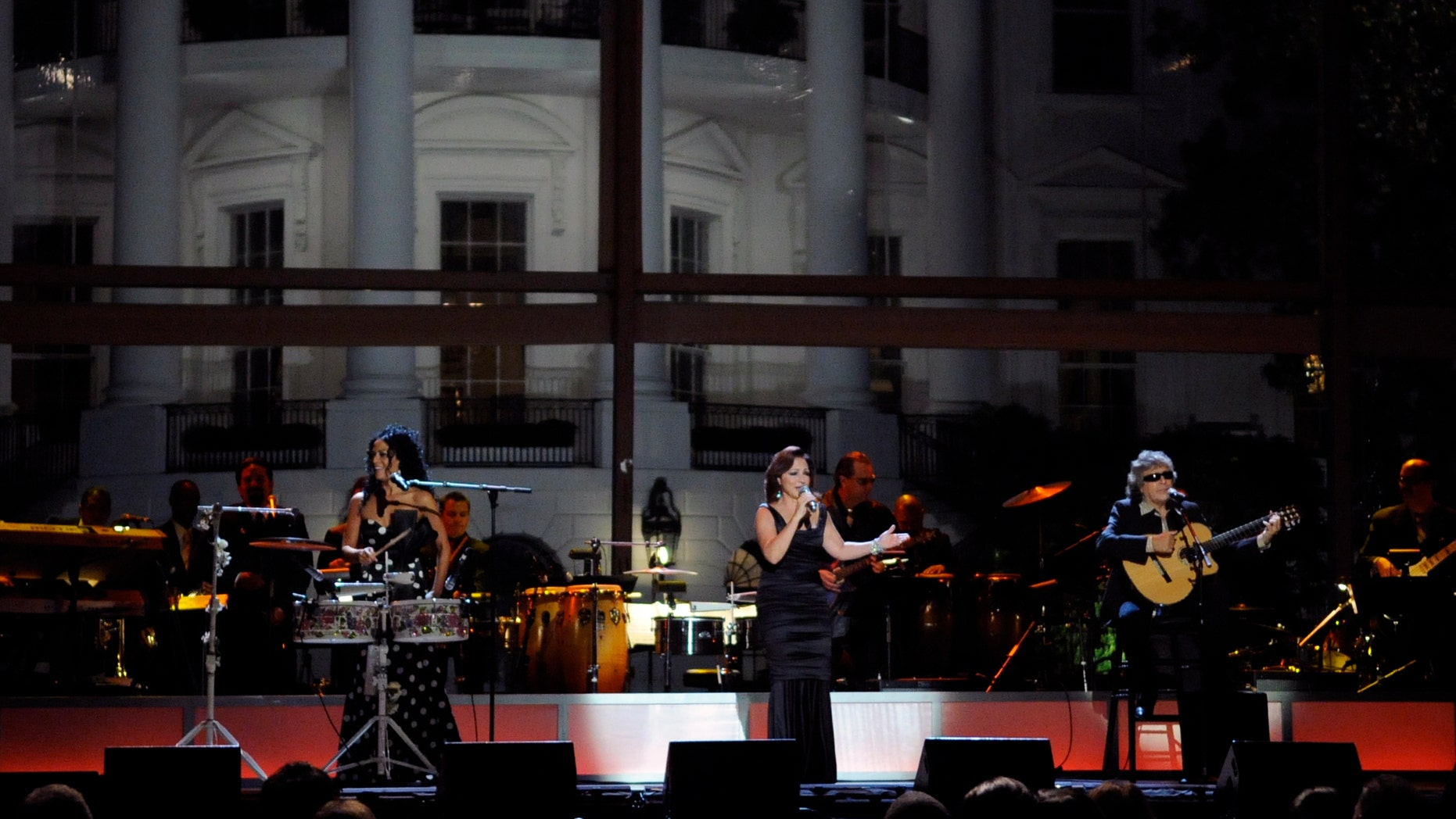 """WASHINGTON - OCTOBER 13:  (L-R) Sheila E., Gloria Estefan and Jose Feliciano perform at the White House music series """"Fiesta Latina"""" on the South Lawn of the White House October 13, 2009  in Washington, DC.  Salsa and Spanish classical music was featured.  (Photo by Alexis C. Glenn-Pool/Getty Images)"""
