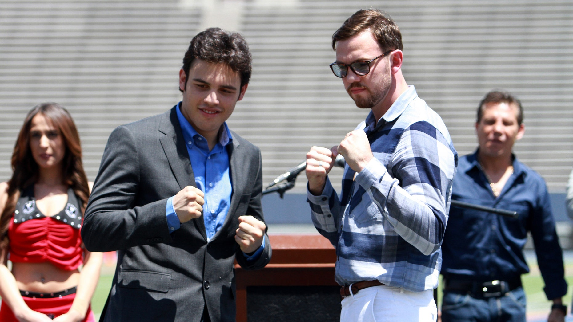Julio Cesar Chavez Jr. left, and his opponent Andy Lee pose for pictures during a news conference in the Sun Bowl stadium in El Paso, Texas.