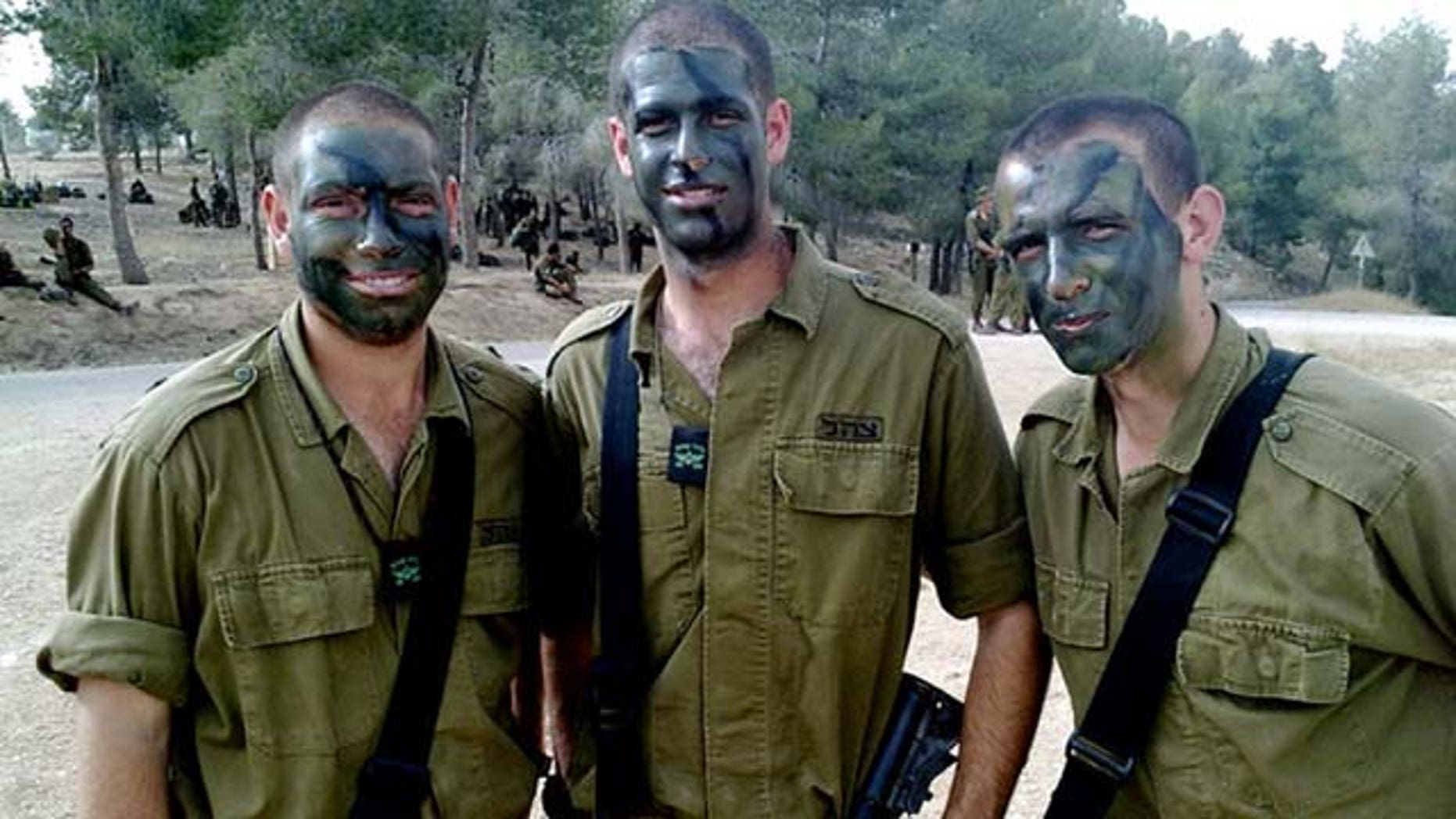 This March 2010 photo provided by Mike Fishbein shows Fishbein, middle, a U.S.-born soldier from Los Angeles, with fellow Americans David Wisefield, left, and Ilan Benjamin, all fighting for the Israel Defense Forces. (AP Photo/Courtesy Mike Fishbein)