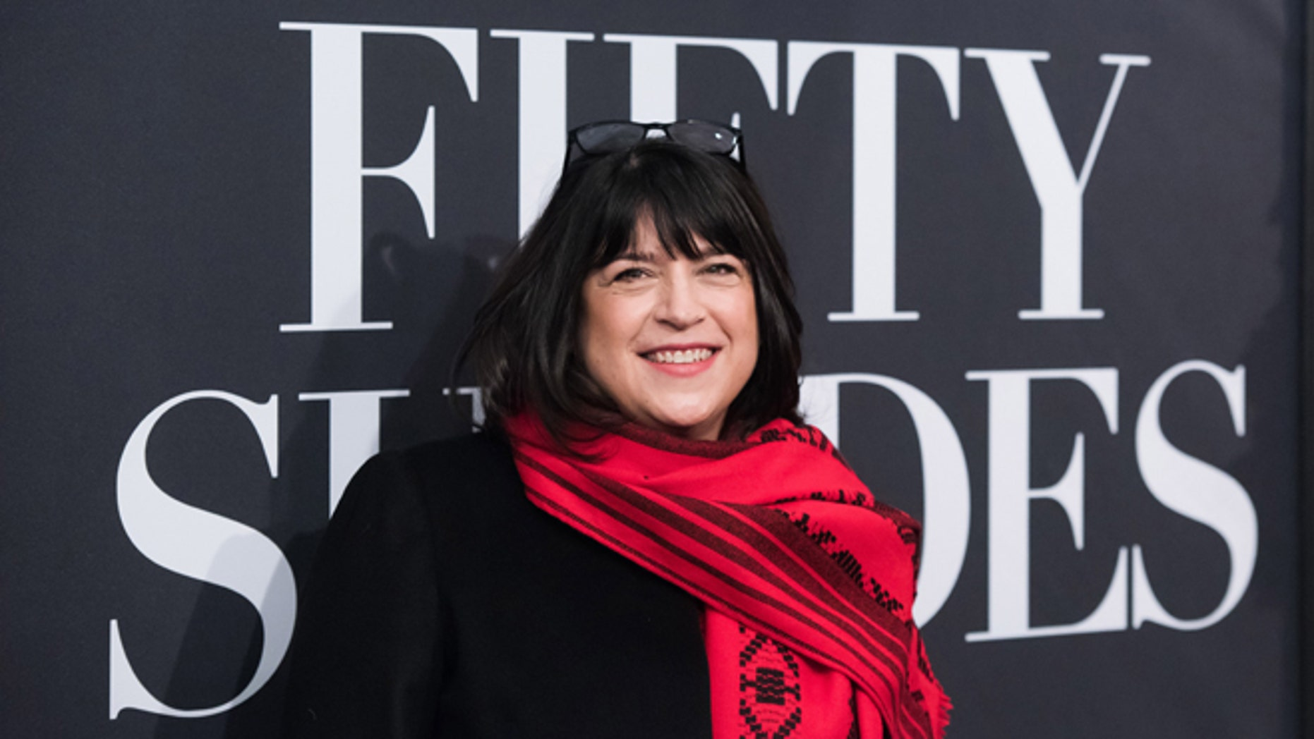 """FILE - In this Feb. 6, 2015 file photo, author EL James attends a special fan screening of """"Fifty Shades of Grey"""" in New York. James, who was also a producer on the film, says shepushed hard on creative decisions to make sure her readers would be happy with the final product. (Photo by Charles Sykes/Invision/AP, File)"""