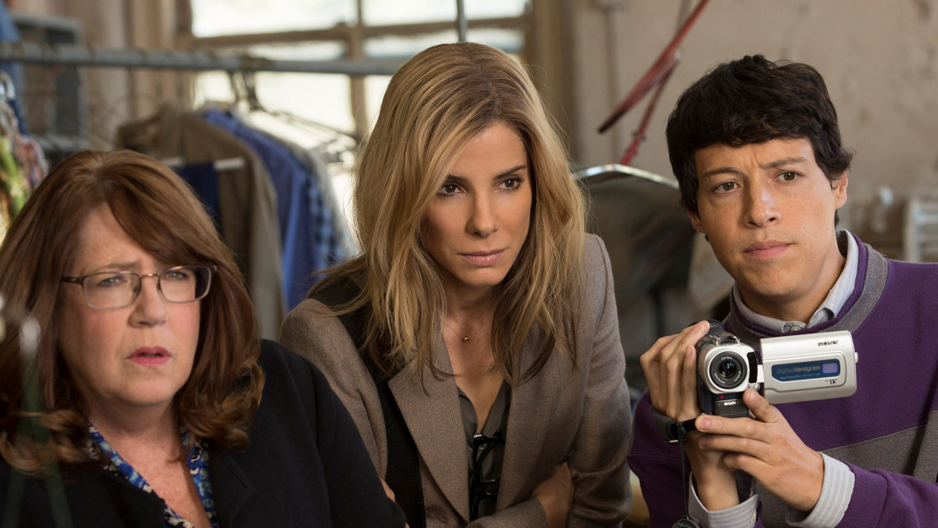 "This photo provided by Warner Bros. Pictures shows, Ann Dowd, from left, as Nell, Sandra Bullock as Jane and Reynaldo Pacheco as Eddie, in Warner Bros. Pictures and Participant Media's satirical comedy ""Our Brand Is Crisis,"" a Warner Bros. Pictures release. The movie opens in U.S. theaters on Oct. 30. (Patti Perret/Warner Bros. Pictures via AP)"