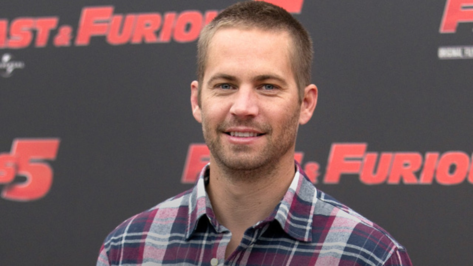 April 29, 2011: Actor Paul Walker poses during the photo call of the movie 'Fast and Furious 5' in Rome. Walker's brothers are filling in to help finish shooting on Fast & Furious 7. (AP Photo/Andrew Medichini, File)