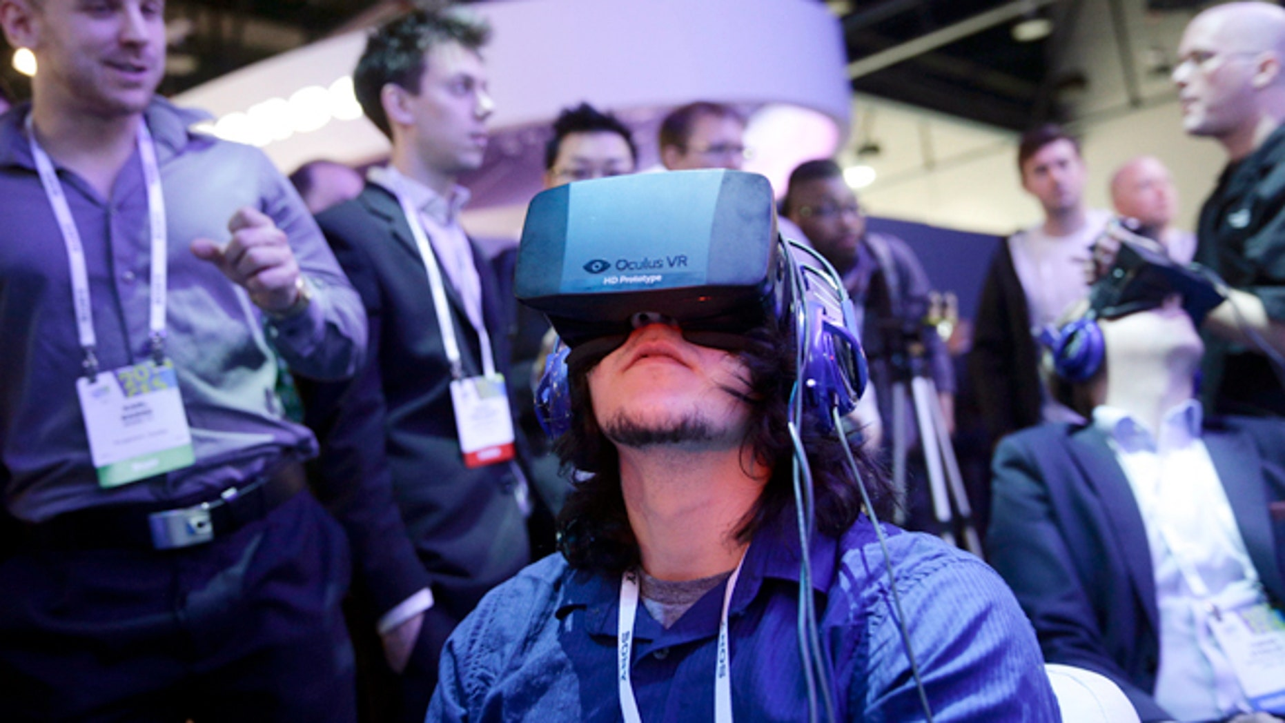 Attendees play a video game wearing Oculus Rift virtual reality headsets at the Intel booth at the International Consumer Electronics Show (CES), in Las Vegas.