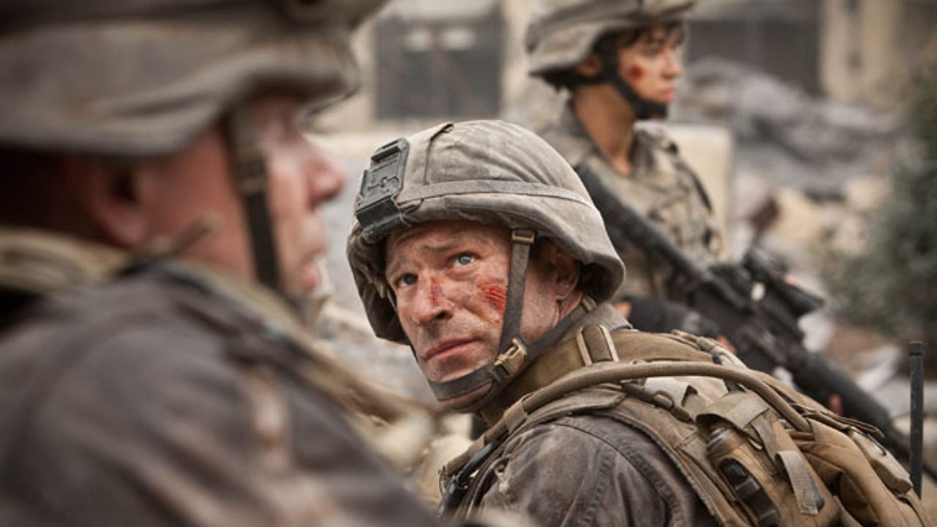 "March 13, 2011: In this film publicity image released by Columbia Pictures, Aaron Eckhart is shown in a scene from ""Battle: Los Angeles."""