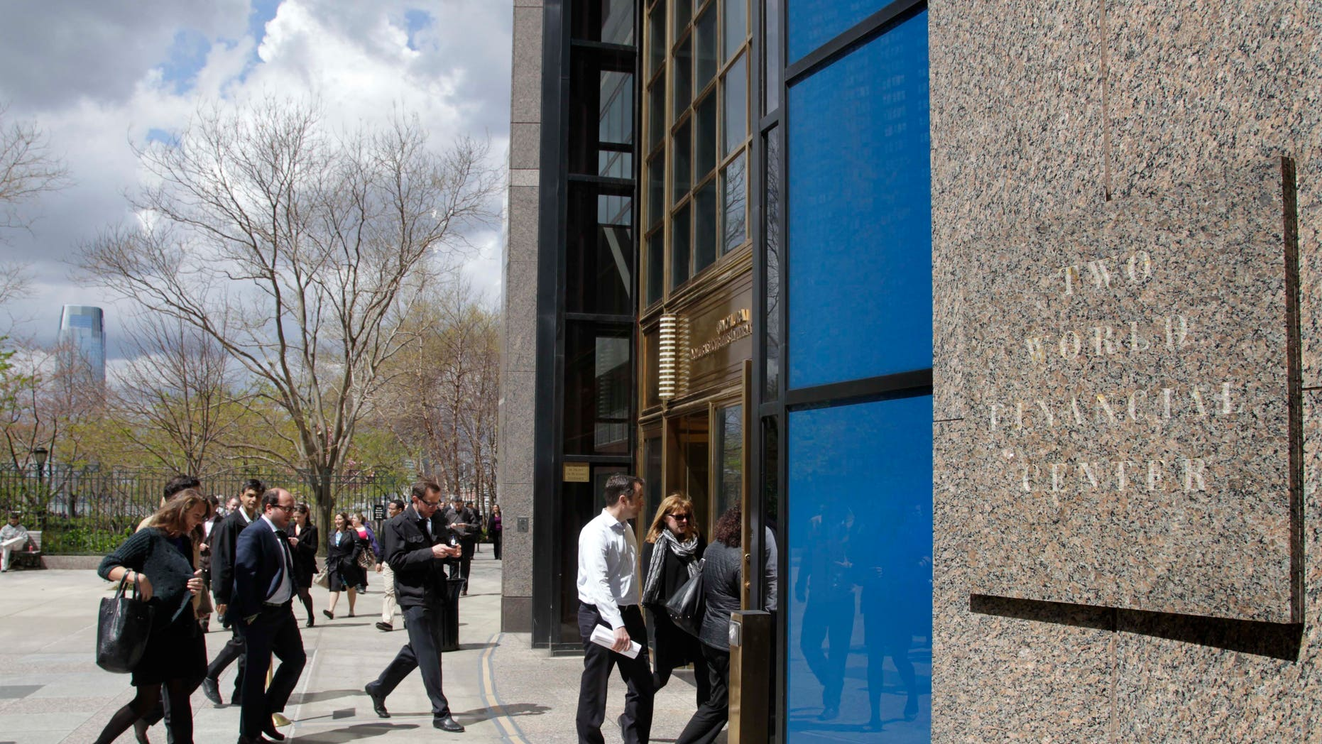 Office workers return to Two World Financial Center after it was briefly evacuated in New York, Thursday, April 12, 2012. Authorities say an evacuation was ordered as a precaution at a World Financial Center building after a security guard reported a package that seemed suspicious. (AP Photo/Seth Wenig)