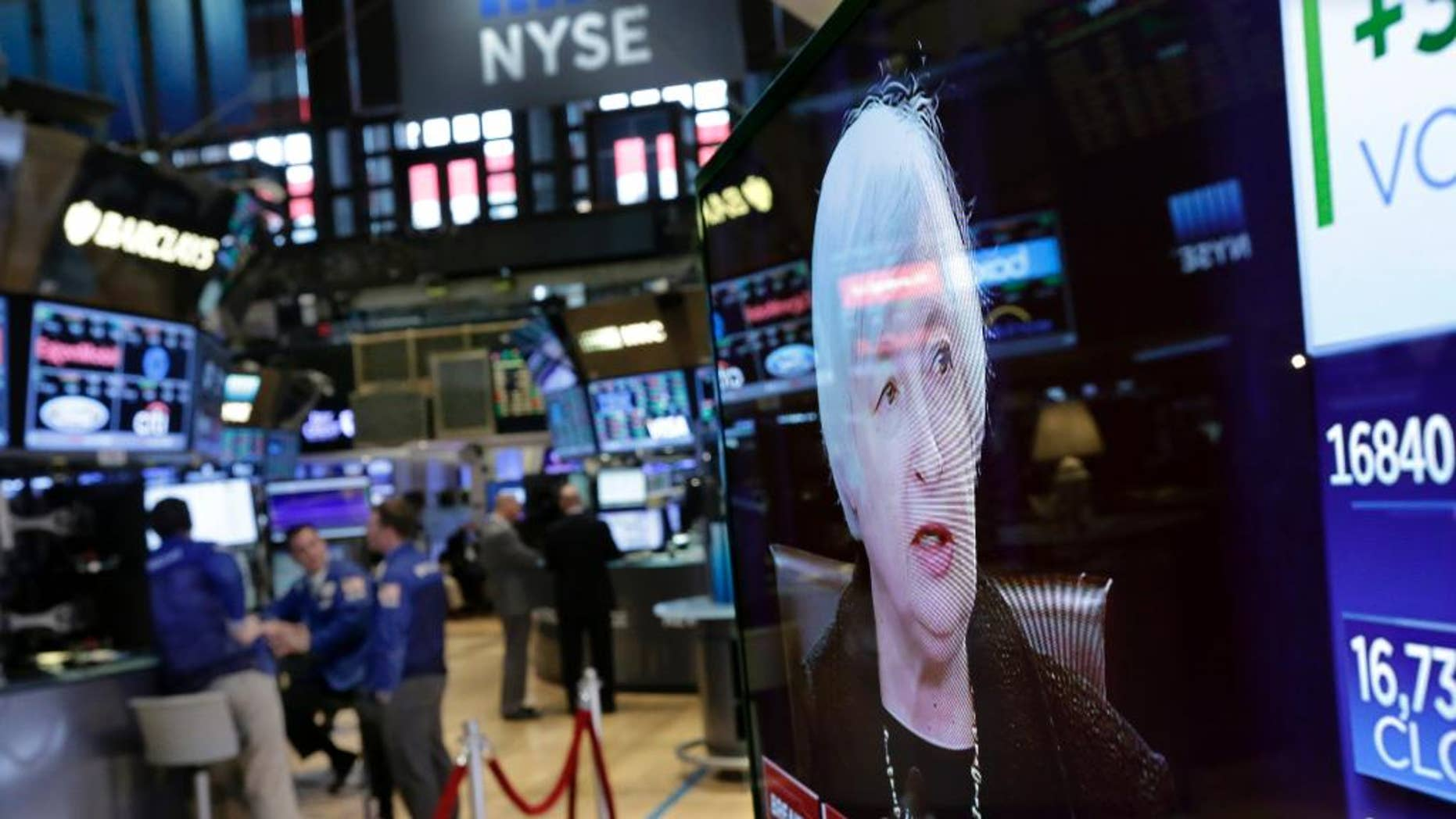 Federal Reserve Chair Janet Yellen's news conference is shown on a television screen, on the floor of the New York Stock Exchange, Thursday, Sept. 17, 2015.