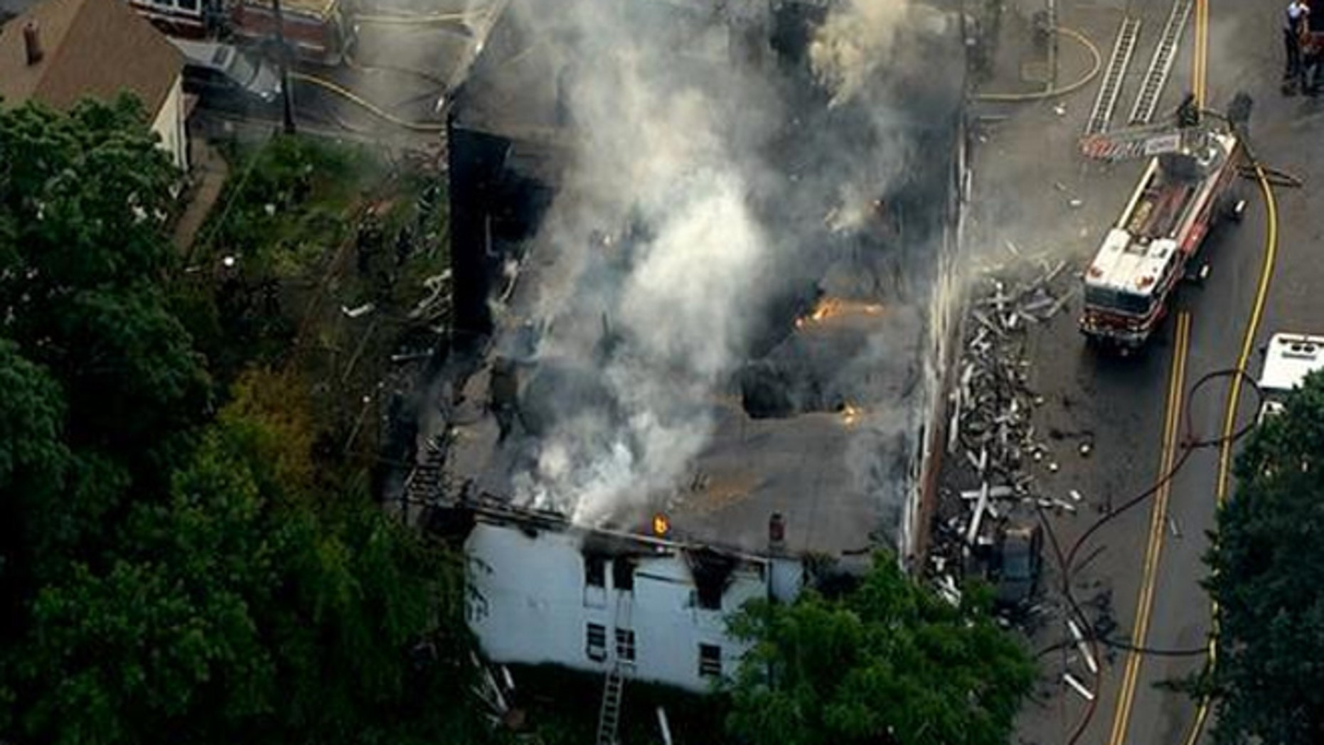 Authorities say seven people died early Thursday morning in a fire at a residential building in Lowell. Witnesses described a chaotic scene.