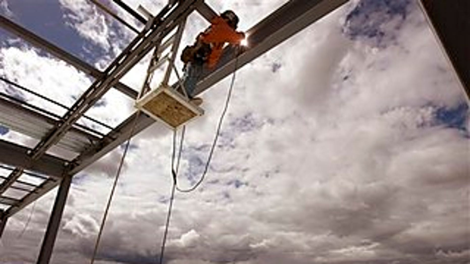 April 13: Welder Andrew Winters works on Facebook's first-ever data center over high desert scrub land in Prineville, Ore. The social networking site chose the high-desert timber town of 10,000 to take advantage of its cool nights and dry air in hopes of making its data center an energy efficiency landmark.