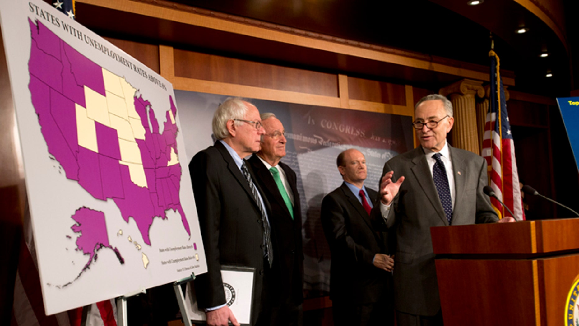 """FILE- In this Dec. 6, 2012, photo, Sen. Charles Schumer, D-N.Y., right, accompanied by from left, Sen. Bernard Sanders, I-Vt., Sen. Tom Harkin, D-Iowa, and Sen. Chris Coons, D-Del., gestures during a news conference the possibility of Americans abruptly their jobless benefits at the of the year on Capitol Hill in Washington,  Hovering in the background of the """"fiscal cliff"""" debate is the prospect of 2 million people losing their unemployment benefits four days after Christmas. (AP Photo/Jacquelyn Martin)"""