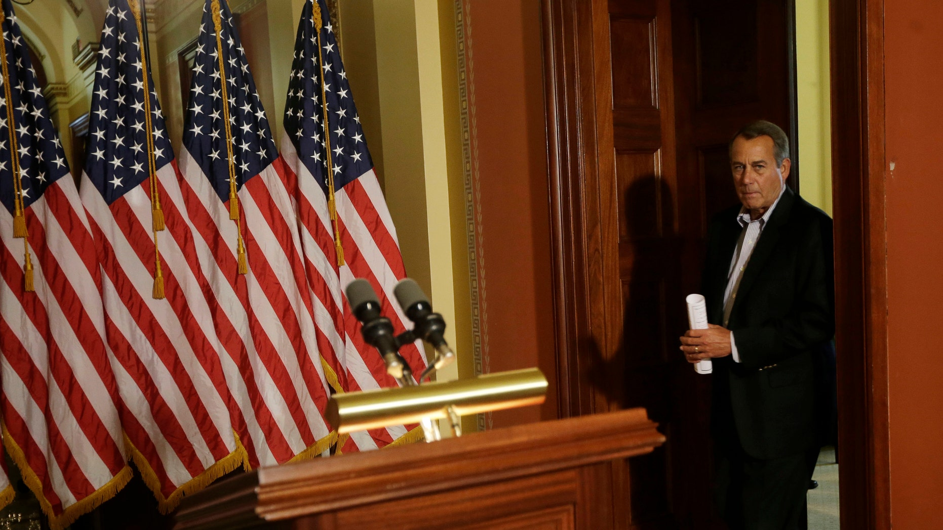House Speaker John Boehner of Ohio arrives for a news conference on Capitol Hill in Washington, Friday, Dec. 7, 2012, to discuss the pending fiscal cliff.  Boehner said there's been no progress in negotiations on how to avoid the fiscal cliff of tax hikes and spending cuts and called on President Barack Obama to come up with a new offer.  (AP Photo/Pablo Martinez Monsivais)