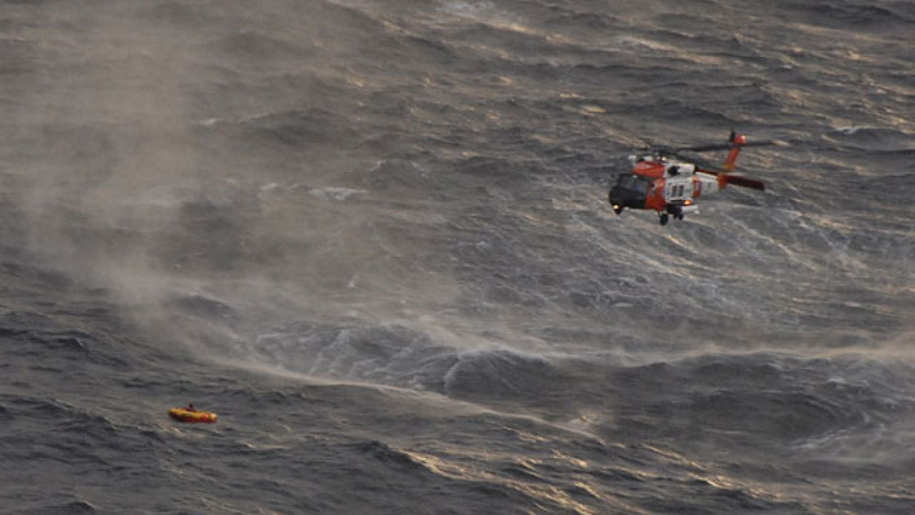 The crew of a Coast Guard Kodiak-based rescue helicopter prepares to rescue one of four crewman from the fishing vessel Northern Belle who managed to climb into a life raft dropped by a Coast Guard aircraft from Air Station Kodiak 50 miles south of Monatgue Island in the Gulf of Alaska. The Northern Belle crew issued a mayday call and abandoned the 75-foot Seattle-based vessel into the chilly waters of the Gulf of Alaska.
