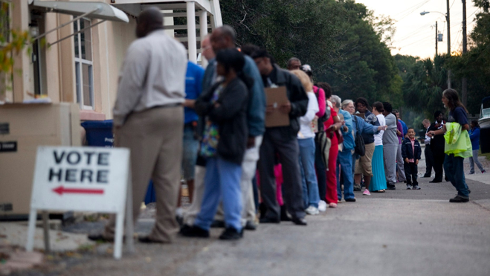 ST. PETERSBURG, FL - NOVEMBER 6:  Lines of voters wait to cast their ballots as the polls open November 6, 2012 in St. Petersburg, Florida. The swing state of Florida is a hotly-contested battleground that offers 29 electoral votes. (Photo by Edward Linsmier/Getty Images)