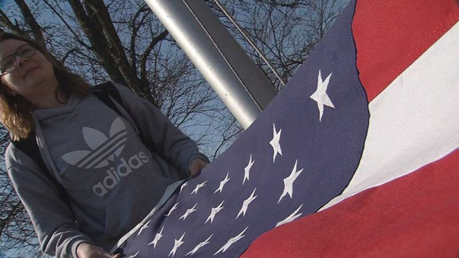 Cameron Carroll, a junior at South Oldham High School in Crestwood, Kentucky, is one of the students that tend to the stars and stripes every day after class. (WDRB Media)