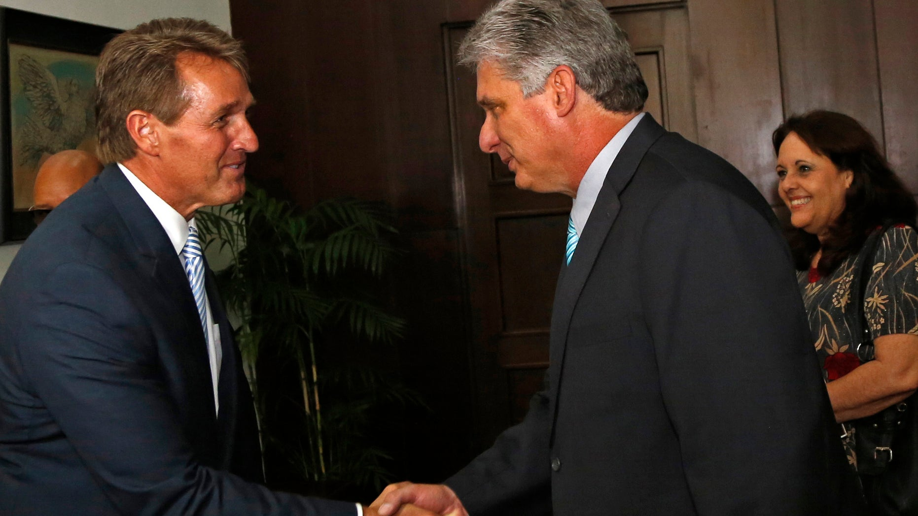 Sen. Jeff Flake, R-Ariz, shakes hands with Cuba's First Vice President Miguel Diaz Canel, at Revolution Palace, in Havana, Cuba, Saturday, June 13, 2015. (AP Photo/Desmond Boylan, Pool)
