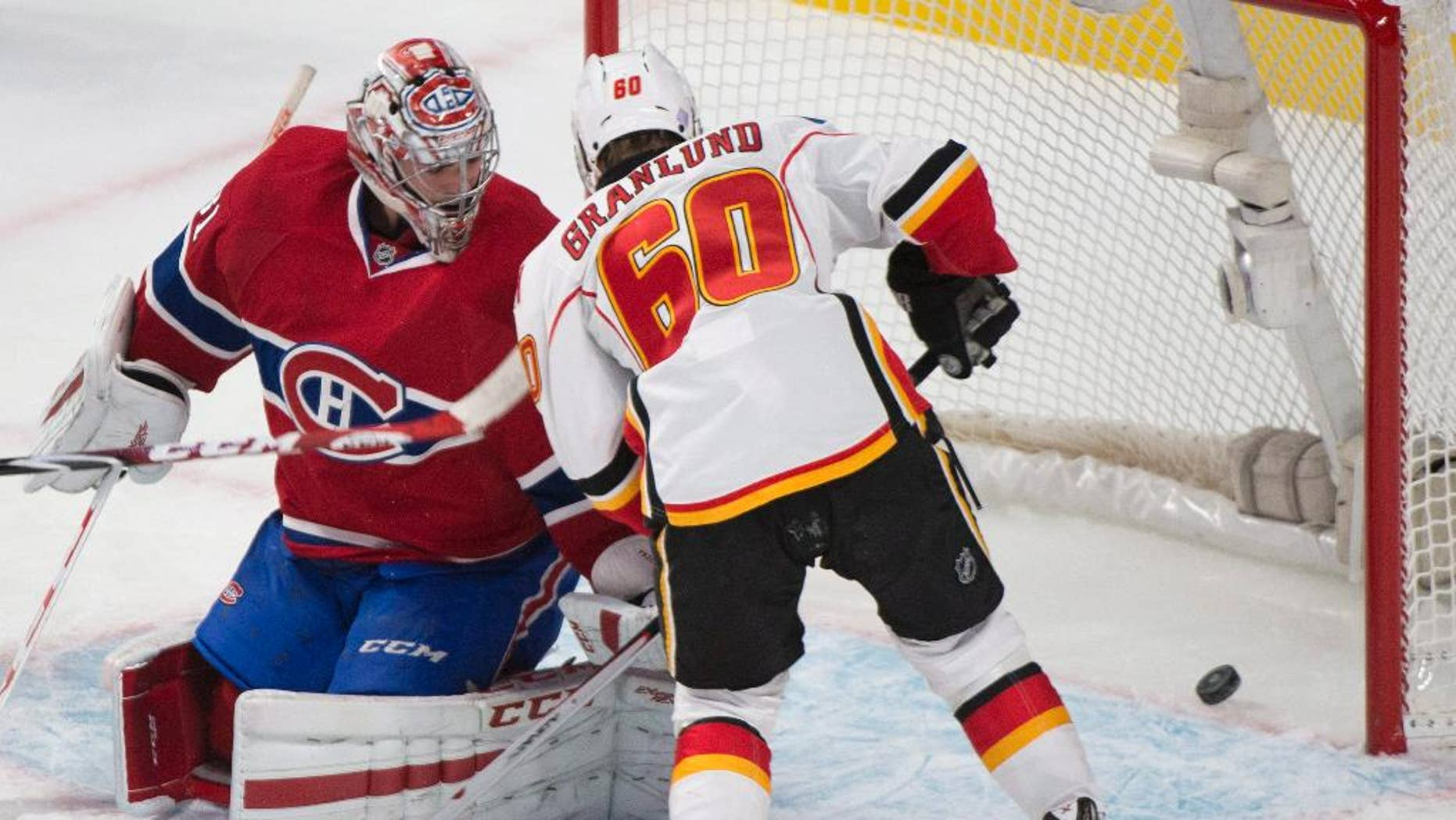 Montreal Canadiens goaltender Carey Price is scored on by Calgary Flames' Markus Granlund during first period NHL hockey action in Montreal, Sunday, Nov. 2, 2014. (AP Photo/The Canadian Press, Graham Hughes)