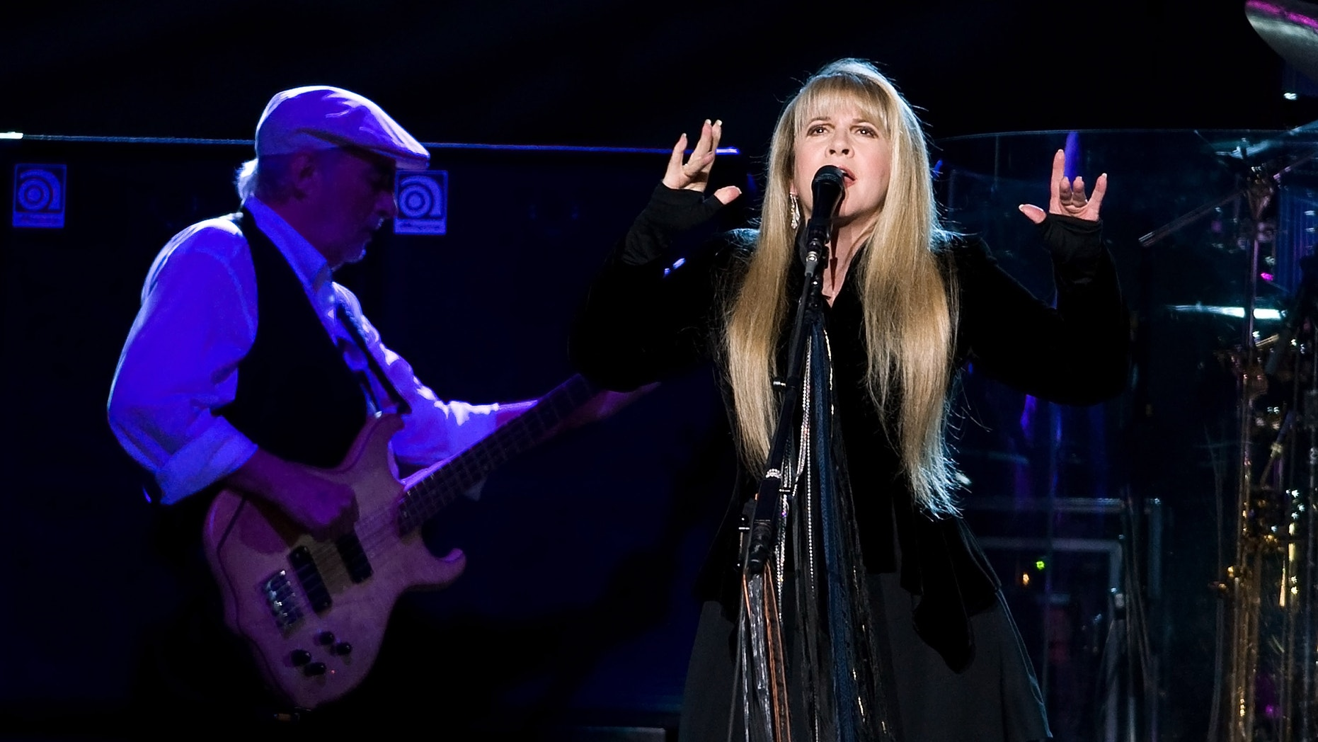 This March 19, 2009 file photo shows John McVie, left, and Stevie Nicks of Fleetwood Mac performing at Madison Square Garden in New York.