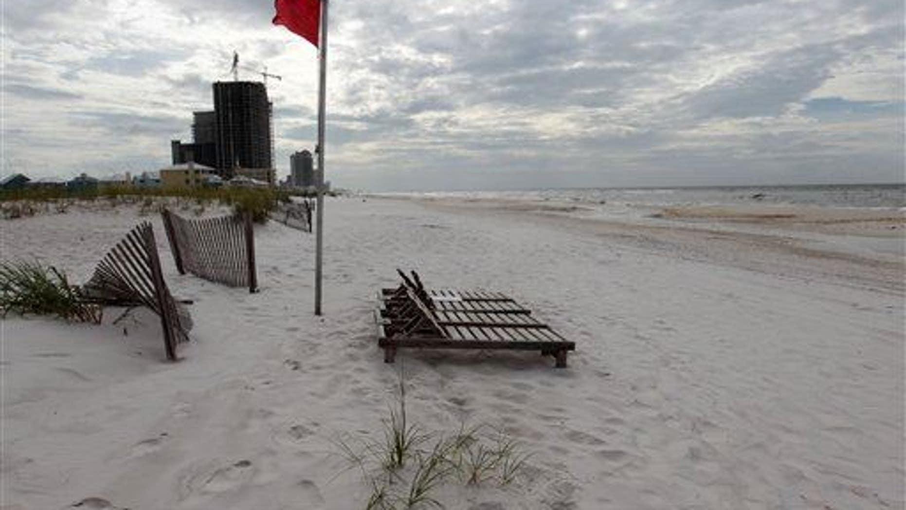 An empty beach is shown in Orange Beach, Ala.